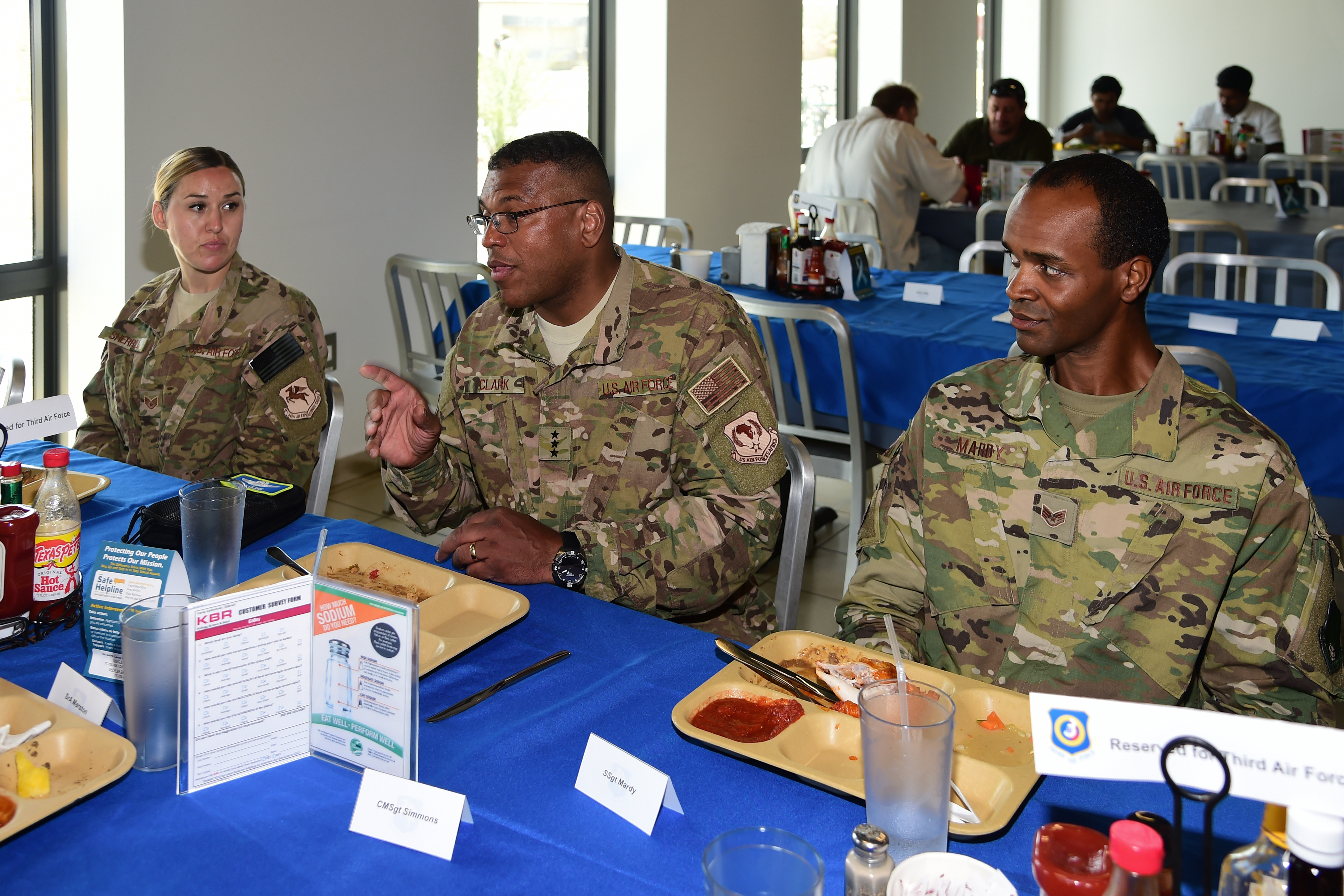 U.S. Air Force Staff Sgt. Jennifer Sherrill with the 870th Air Expeditionary Squadron, and Staff Sgt. Brian Mardy with the 81st Expeditionary Rescue Squadron join Lt. Gen. Richard Clark, commander of the 3rd Air Force and 17th Expeditionary Air Force for lunch at Camp Lemonnier, Djibouti April 12, 2017. Clark was accompanied by Chief Master Sgt. Phillip Easton, U.S. Air Forces Europe and U.S. Air Forces Africa command chief, on a visit with deployed Airmen, to gain a better understanding of the Air Force mission in East Africa, and express their appreciation to the many U.S. Airmen deployed throughout the region. (U.S. Air National Guard photo by Master Sgt. Paul Gorman)