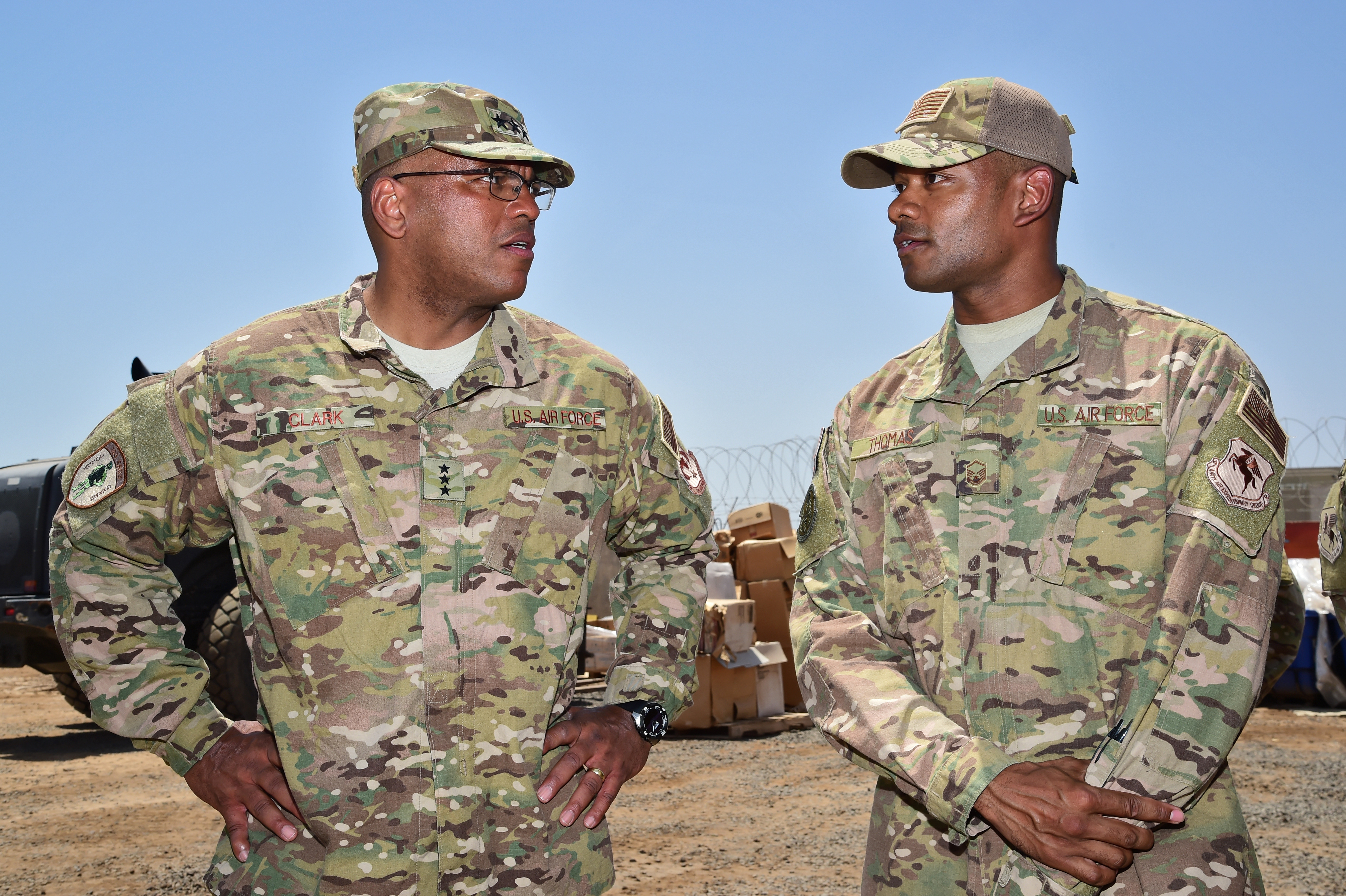 Lt. Gen. Richard Clark, commander of the 3rd Air Force and 17th Expeditionary Air Force, speaks with Master Sgt. Lamar Thomas, chief of supply for the 726th Expeditionary Air Base Squadron during a visit to Camp Lemonnier, Djibouti April 12, 2017. The visit allowed Clark and accompanying leadership to gain a better understanding of the Air Force mission in East Africa, and express their appreciation to the many U.S. Airmen deployed throughout the region. (U.S. Air National Guard photo by Master Sgt. Paul Gorman)