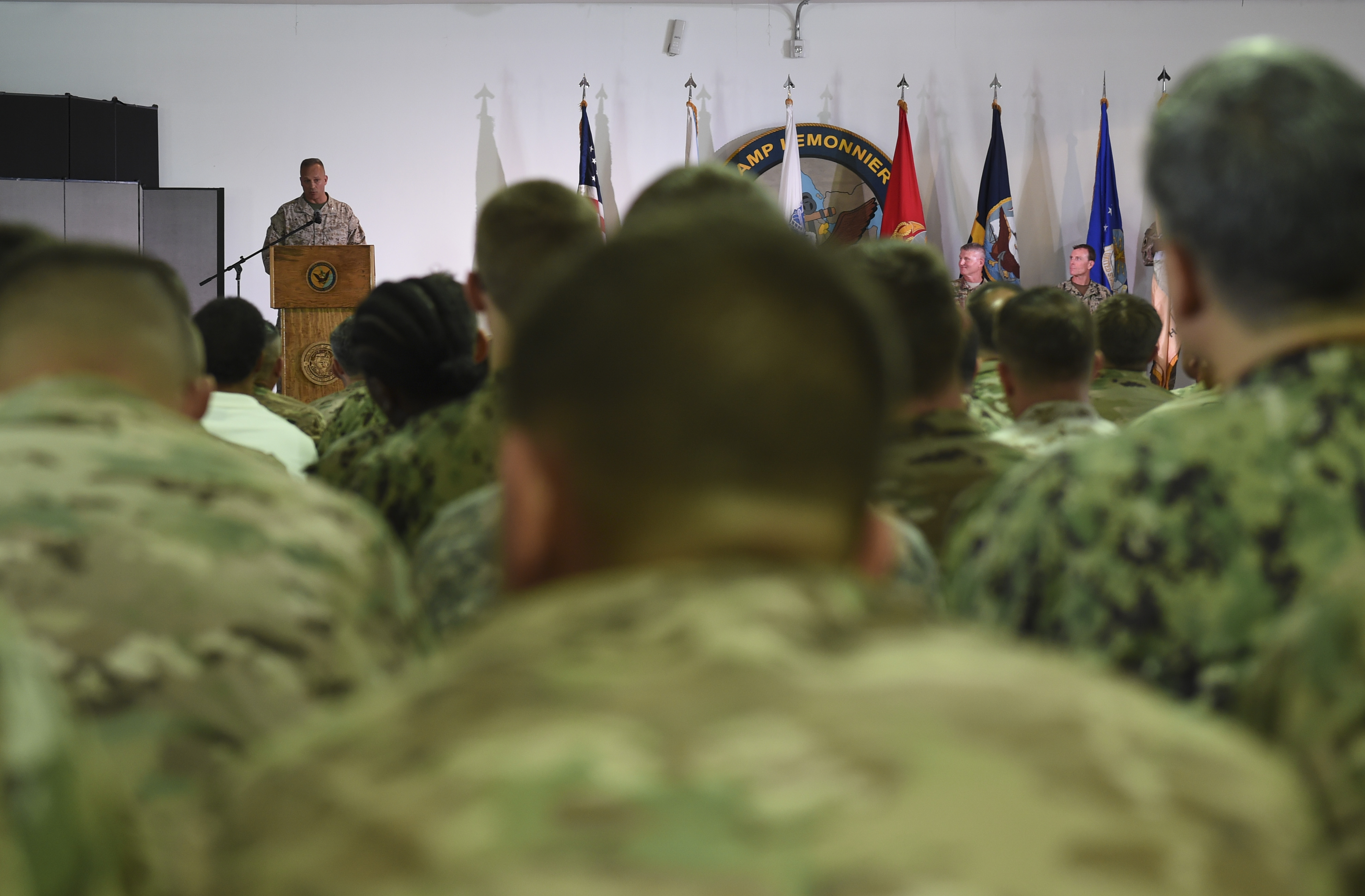 U.S. Marine Corps Brig. Gen. David J. Furness Combined Joint Task Force - Horn of Africa commander, addresses the audience during the change of command ceremony on Camp Lemonnier in Djibouti, April 28, 2017. Furness is responsible for overseeing CJTF-HOA's efforts in countering transnational threats in East Africa, fostering regional security cooperation, and ultimately promoting regional stability and prosperity. (U.S. Air Force Photo by Eboni Prince)