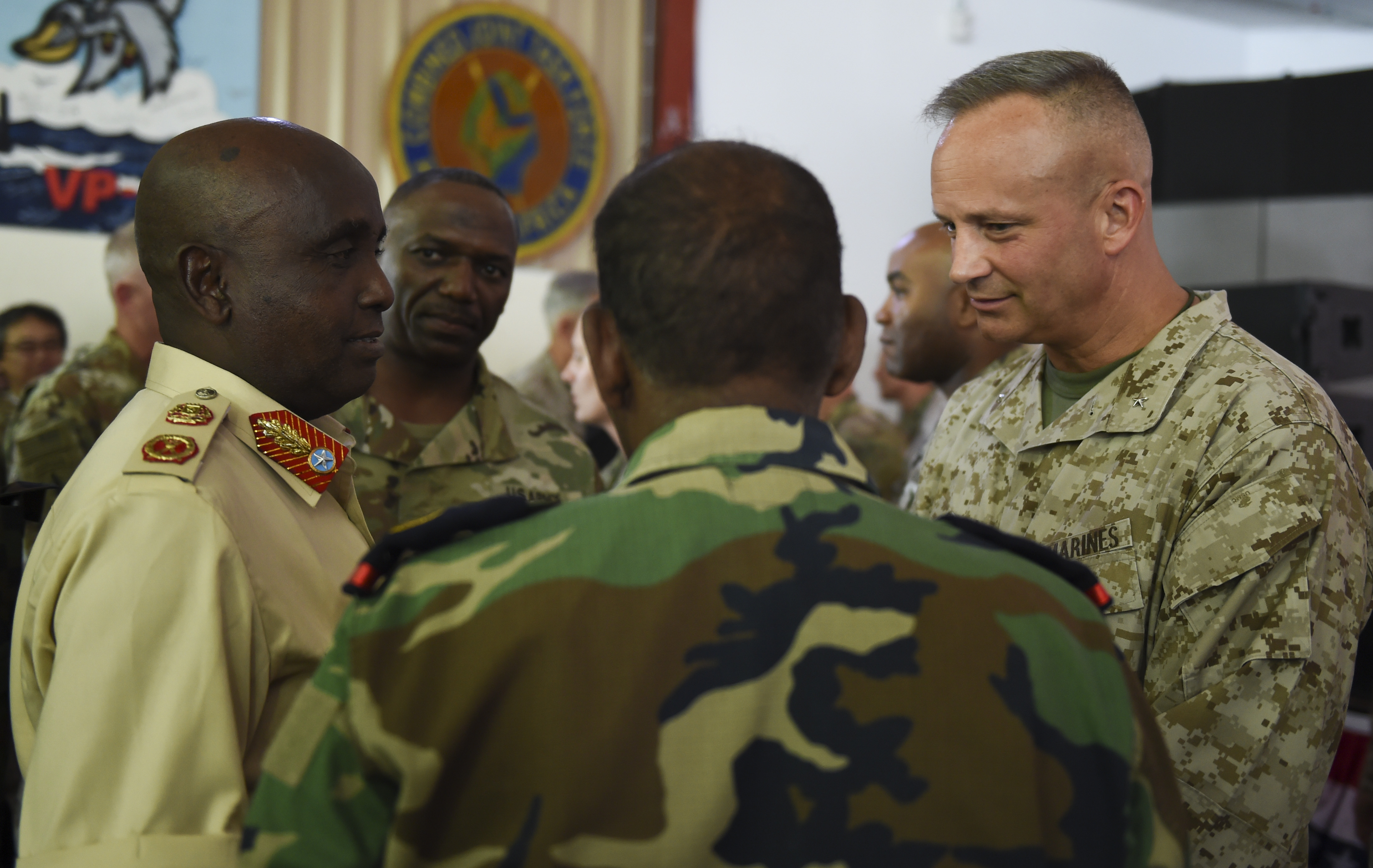 U.S. Marine Corps Brig. Gen. David J. Furness, Combined Joint Task Force - Horn of Africa commander, speaks with regional partners from East Africa after the change of command ceremony on Camp Lemonnier in Djibouti, April 28, 2017. Furness has participated in contingency operations in the Republic of Panama and in the following named operations: Operation Provide Comfort, Operation Unified Assistance, Operation Iraqi Freedom, and Operation Enduring Freedom. (U.S. Air Force Photo by Eboni Prince)