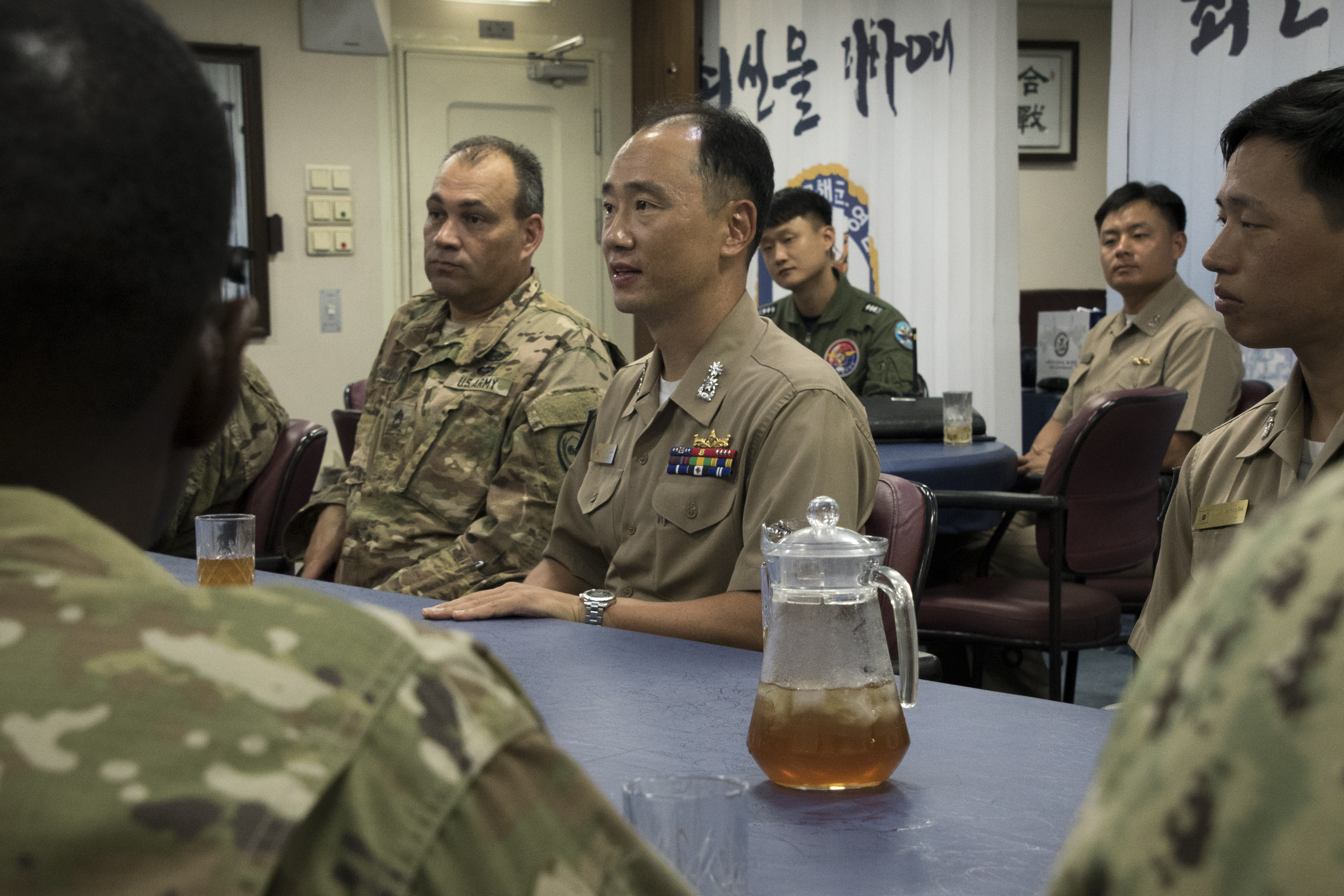South Korean Navy Capt. Kim Kyung-Ryul, Commander of the Republic of Korea Choi-Young DDH-981, serves traditional tea to Combined Joint Task Force-Horn of Africa members who joined members of Camp Lemonnier, Djibouti, in a visit to ROKS Choi Young DDH-981, May 8, 2017. The ship is a Chungmugong Yi Sun-sin-class destroyer in the South Korean navy. (U.S. Air National Guard photo by Tech. Sgt. Joe Harwood)