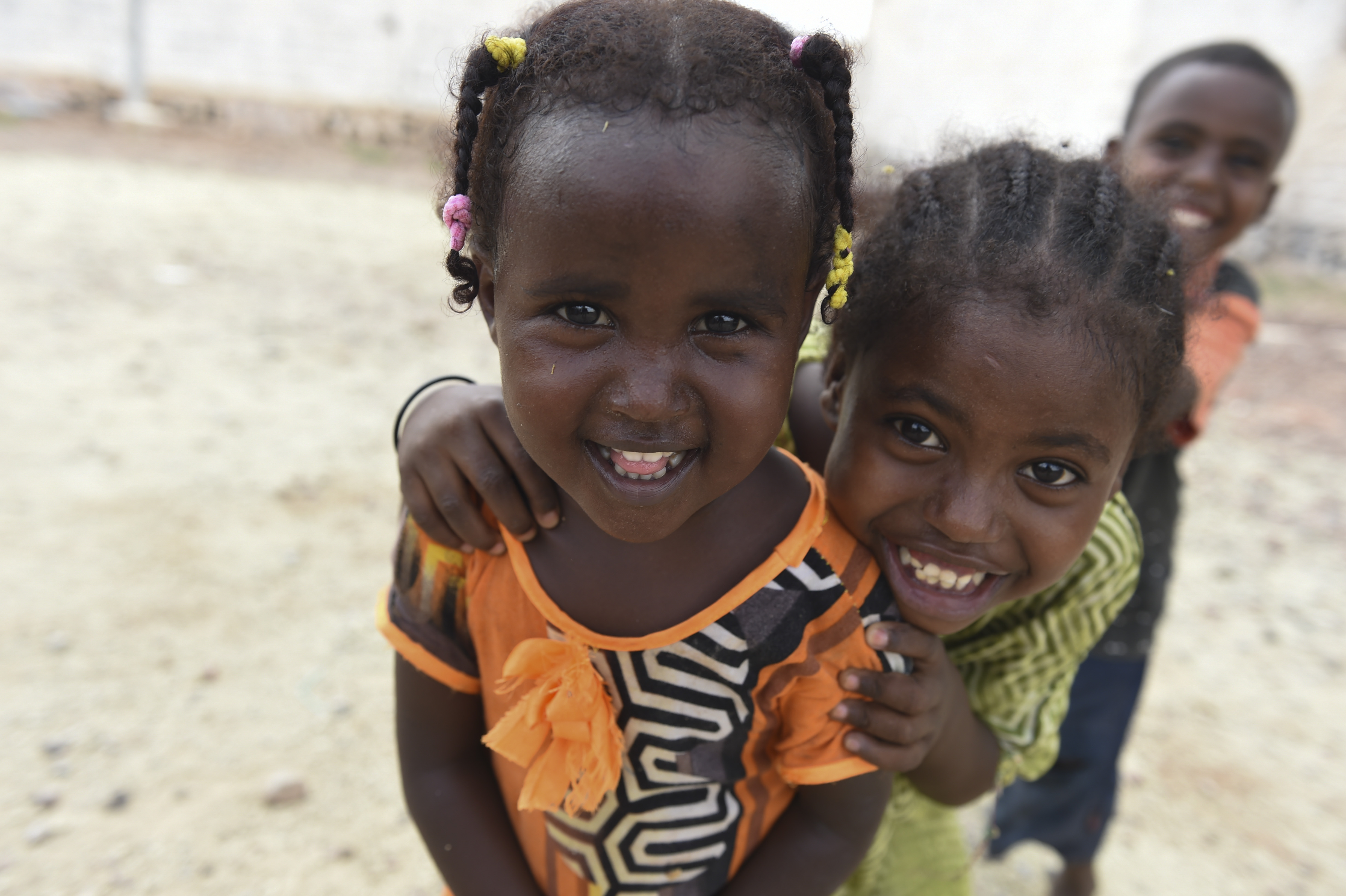 Children pose for a picture in Holhol, Djibouti, May 18, 2017. The 411th Civil Affairs Battalion, Bravo Company, Civil Affairs Team 3, travelled to the village of Holhol to conduct a counter-violent-extremism assessment in support of the Combined Joint Task Force- Horn of Africa's effort to neutralize violent extremist organizations in the region to create a stable, secure environment in East Africa. (U.S. Air Force Photo by Eboni Prince)