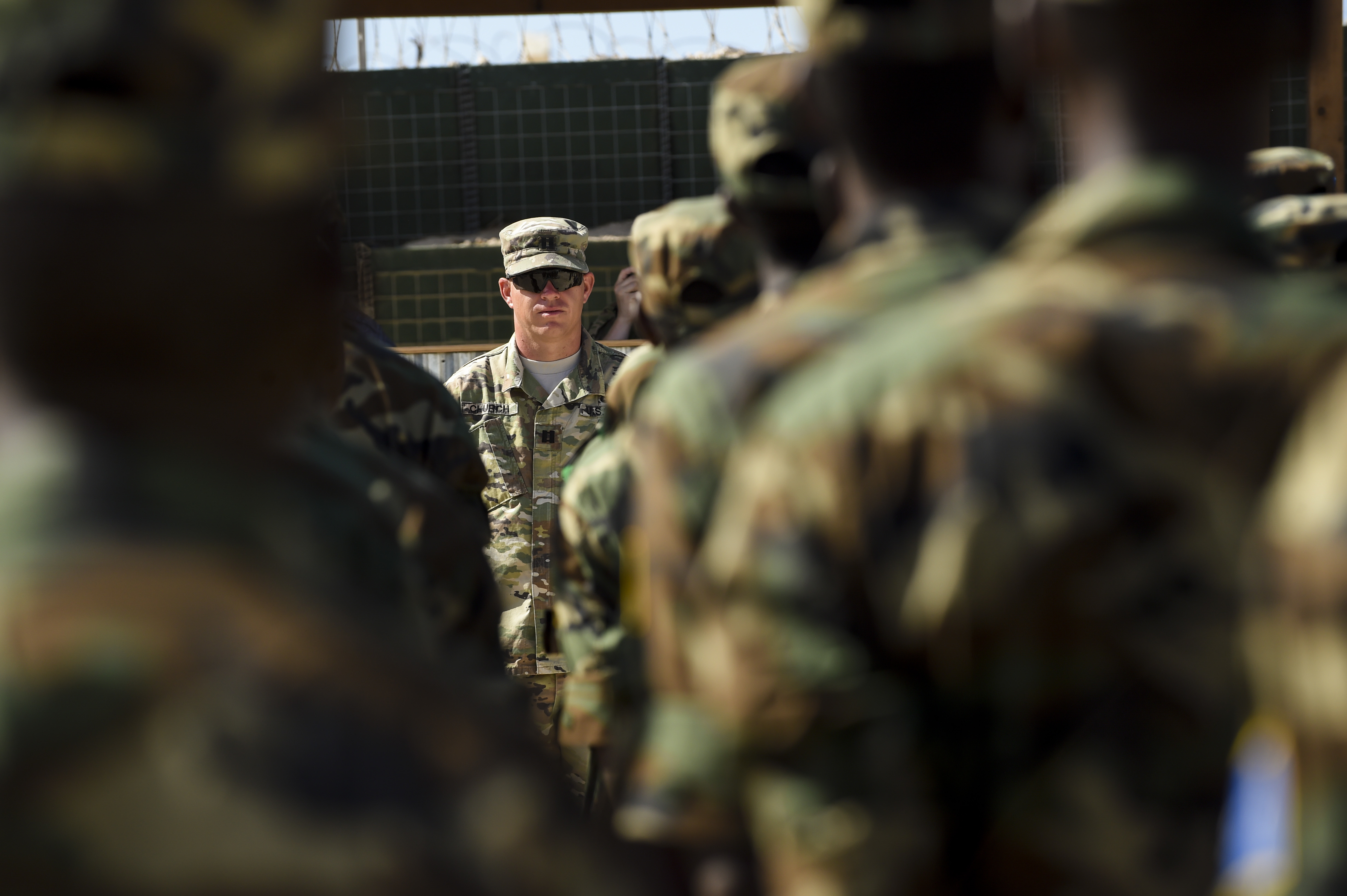 U.S. Army Capt. Seth Church with the 101st Airborne Division stands in front of a military formations of Somali National Army soldiers during a graduation ceremony May 24, 2017, in Mogadishu, Somalia. Church was one of five trainers the U.S. sent at the request of the Federal Government of Somalia to train its soldiers on logistics. (U.S. Air Force photo by Staff Sgt. Nicholas M. Byers)