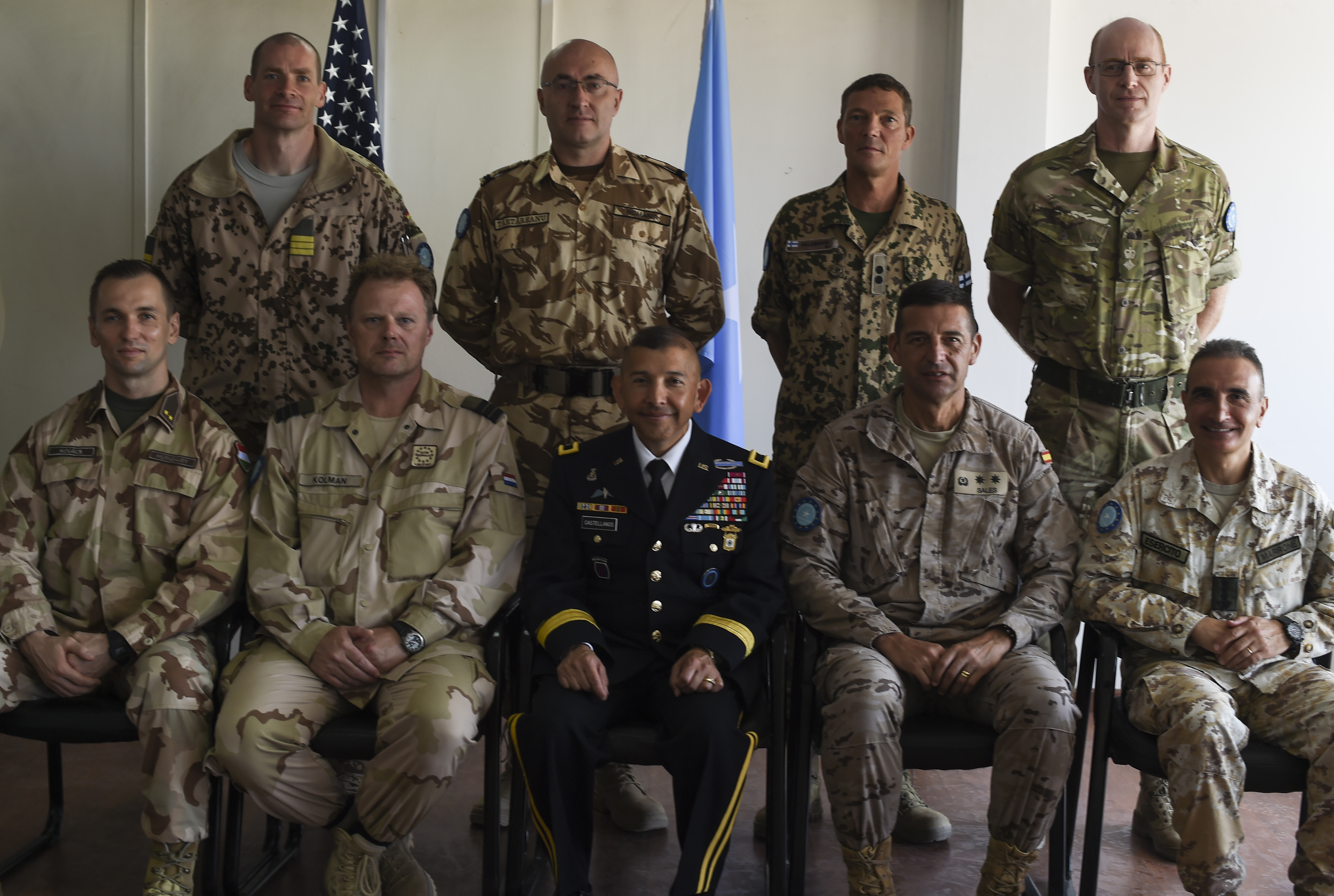 U.S. Army Brig. Gen. Miguel Castellanos (bottom, center), Combined Joint Task Force-Horn of Africa deputy commanding general in Somalia and Mogadishu Coordination Cell director, is seated with international military partners at the MCC, June 4, 2017. Castellanos works from the Mogadishu International Airport compound with his team to support combined military efforts to achieve U.S. Africa Command's top priority of defeating Al-Shabaab in Somalia and successfully transitioning security functions to Somali National Security Forces. (U.S. Air Force photo by Staff Sgt. Eboni Prince)
