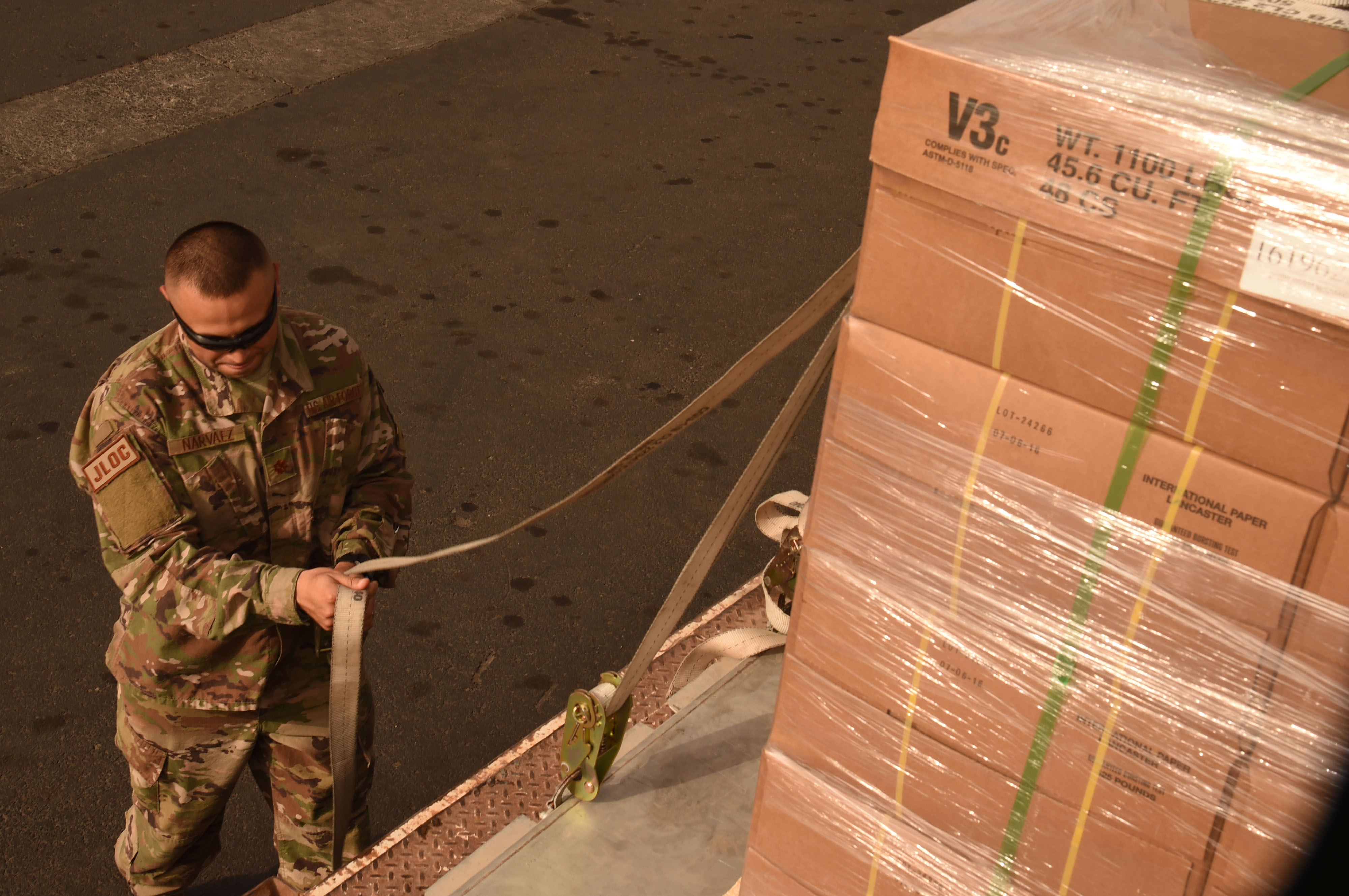 U.S. Air Force Maj. Christopher Narvaez, CJTF-HOA Joint Logistics Operations Center deputy branch chief, helps to tie down the pallet readied for the Air Transportation and Refueling Exchange of Service (ATARES) proof-of-concept mission, at the Djibouti International Airport, Djibouti, June 6, 2017. ATARES is a mutually accepted cash-free exchange of services between nations that provides support in air force activity, to include airlift, air refueling, aeromedical evacuation, and flight simulations. (U.S. Air National Guard Tech. Sgt. Andria Allmond)