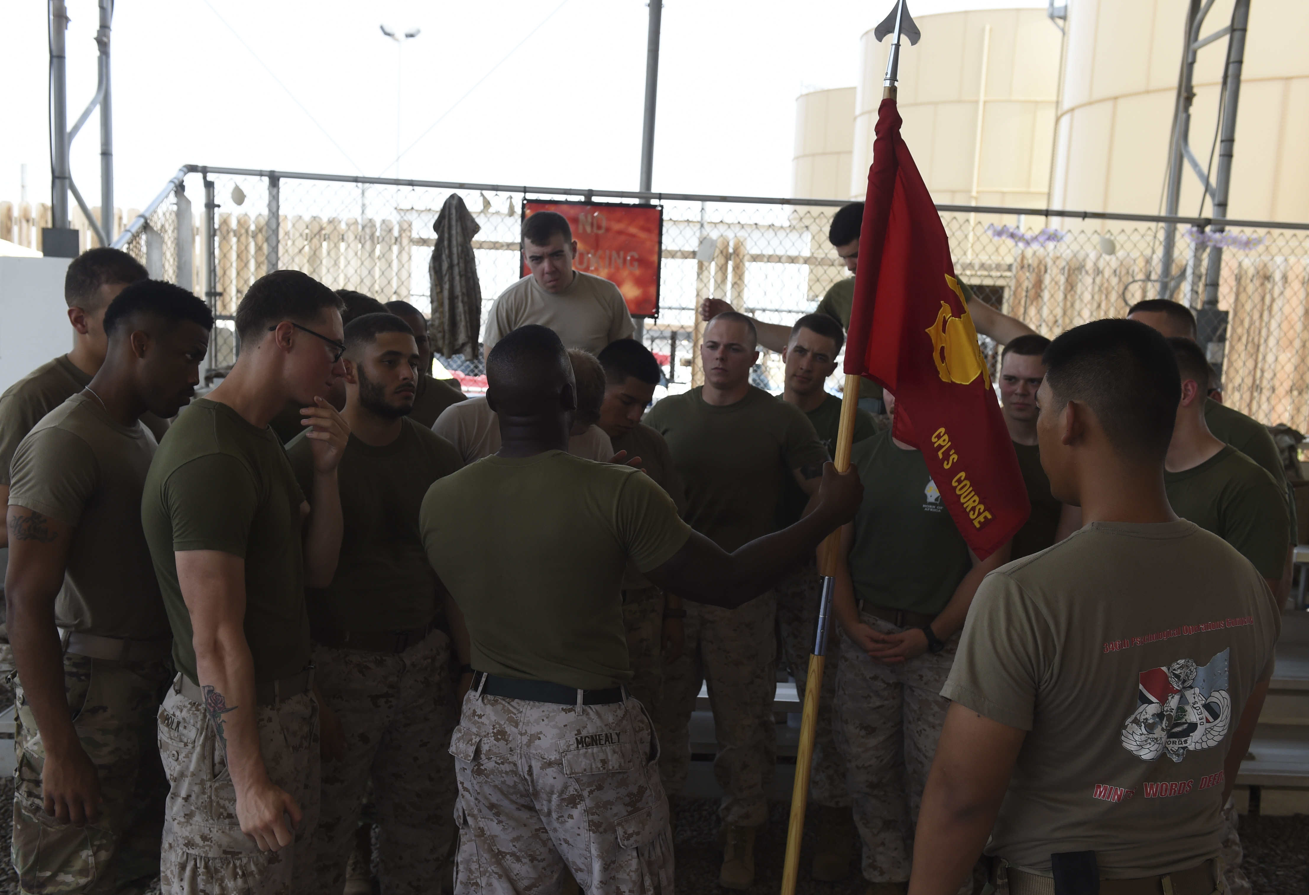 U.S. Marine Corps Sgt. Tyree McNealy, assigned to Combined Joint Task Force-Horn of Africa, speaks to students in the Corporal's Course at Camp Lemonnier, Djibouti, May 24, 2017. The intent of the course is to equip and prepare Marines to smartly transition from being subordinates to being small unit leaders. During this course, Corporals gain insight into key facets of their new grade and responsibilities and are thus prepared to take on future leadership challenges. (U.S. Air Force photo by Staff Sgt. Eboni Prince)