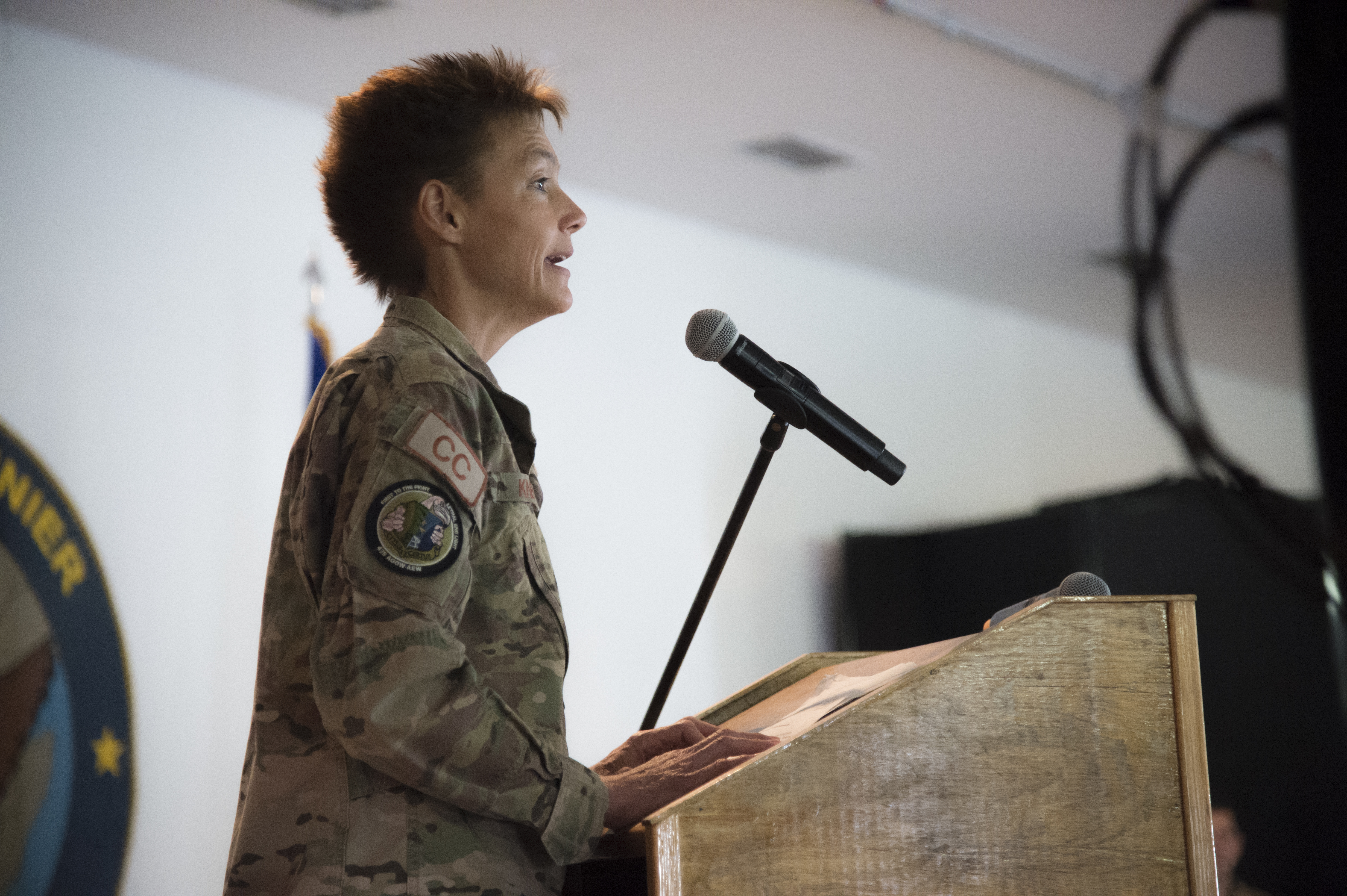 U.S. Air Force Col. Andra Kniep, 435th Air Expeditionary Wing commander, speaks to the crowd during the 449th AEG Change of Command ceremony June 9, 2017, at Camp Lemonnier, Djibouti. CJTF-HOA welcomes new 449th AEG commander  U.S. Air Force Col. Shawn Cochran, 449th Air Expeditionary Group incoming commander, is relieving U.S. Air Force Col. Michael Bruzzini who has served as the 449th AEG Commander since June 6, 2016. The passing of the flag is a military tradition signifying the change of authority and responsibility of a unit from one commander to another. (U.S. Air National Guard Photo by Tech. Sgt. Joe Harwood)