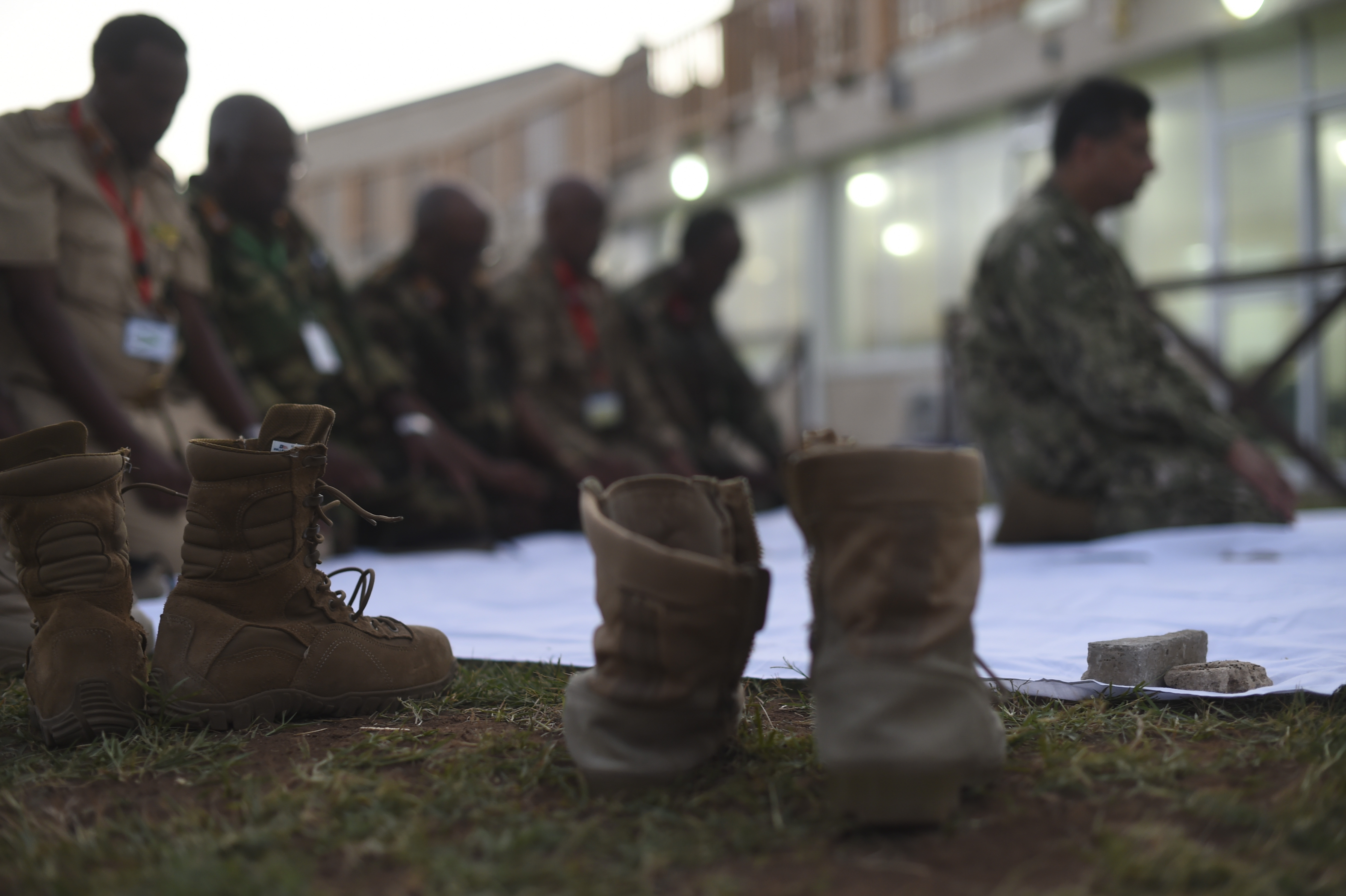 Military boots rest near a sheet placed on the ground for a prayer before an Iftar with members of the Somali National Army at the Mogadishu International Airport, Mogadishu, Somalia, June 5, 2017. This was the first Iftar held between U.S. and SNA military personnel. Additionally, it was the first led by a U.S. Imam, who is a leader in the Islamic faith. (U.S. Air Force Photo by Staff Sgt. Eboni Prince)
