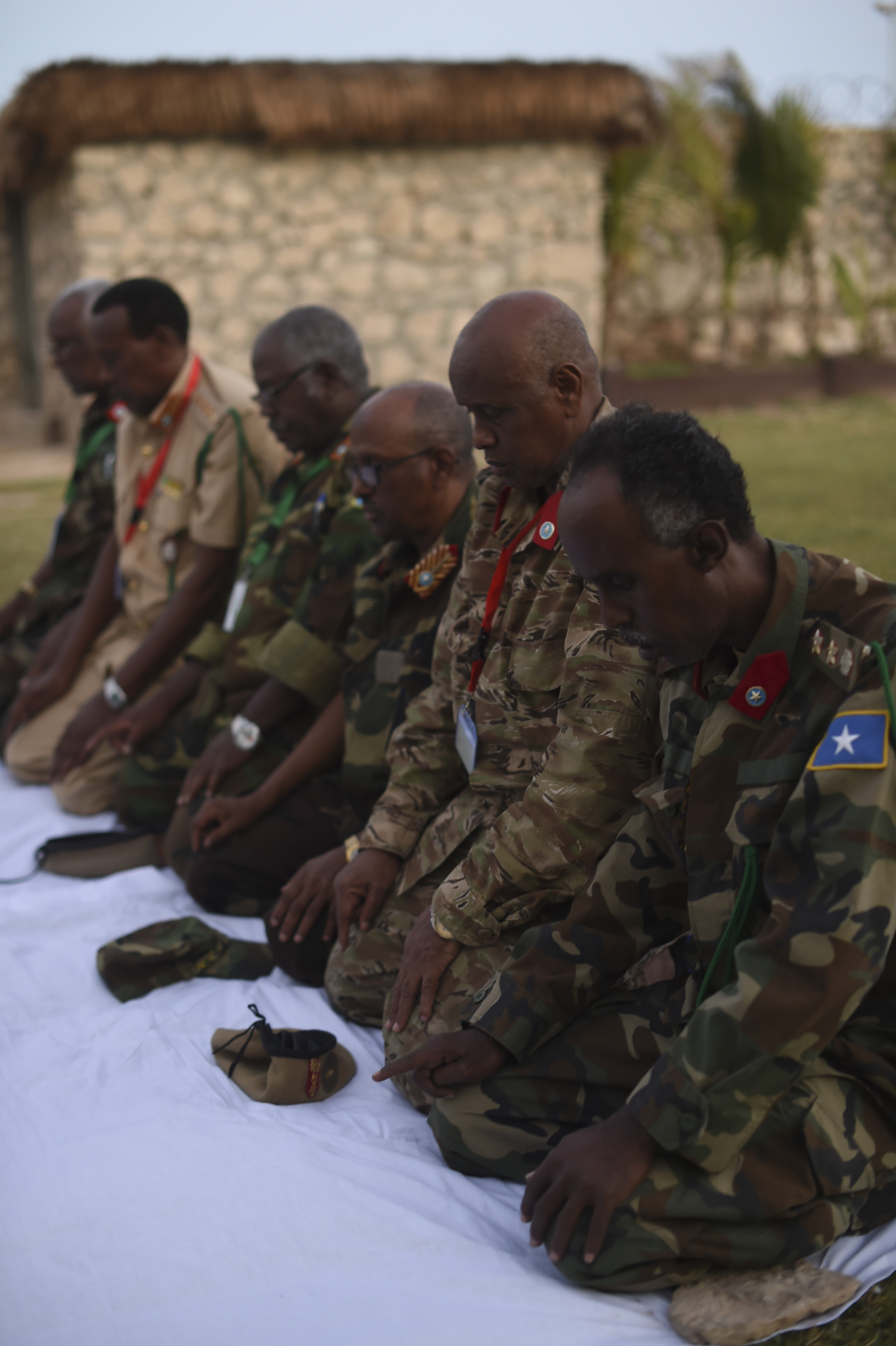 Members of the Somali National Army kneel to pray before an Iftar at the Mogadishu International Airport, Mogadishu, Somalia, June 5, 2017. Iftar is the evening meal when Muslims end their daily Ramadan fast at sunset. (U.S. Air Force Photo by Staff Sgt. Eboni Prince)