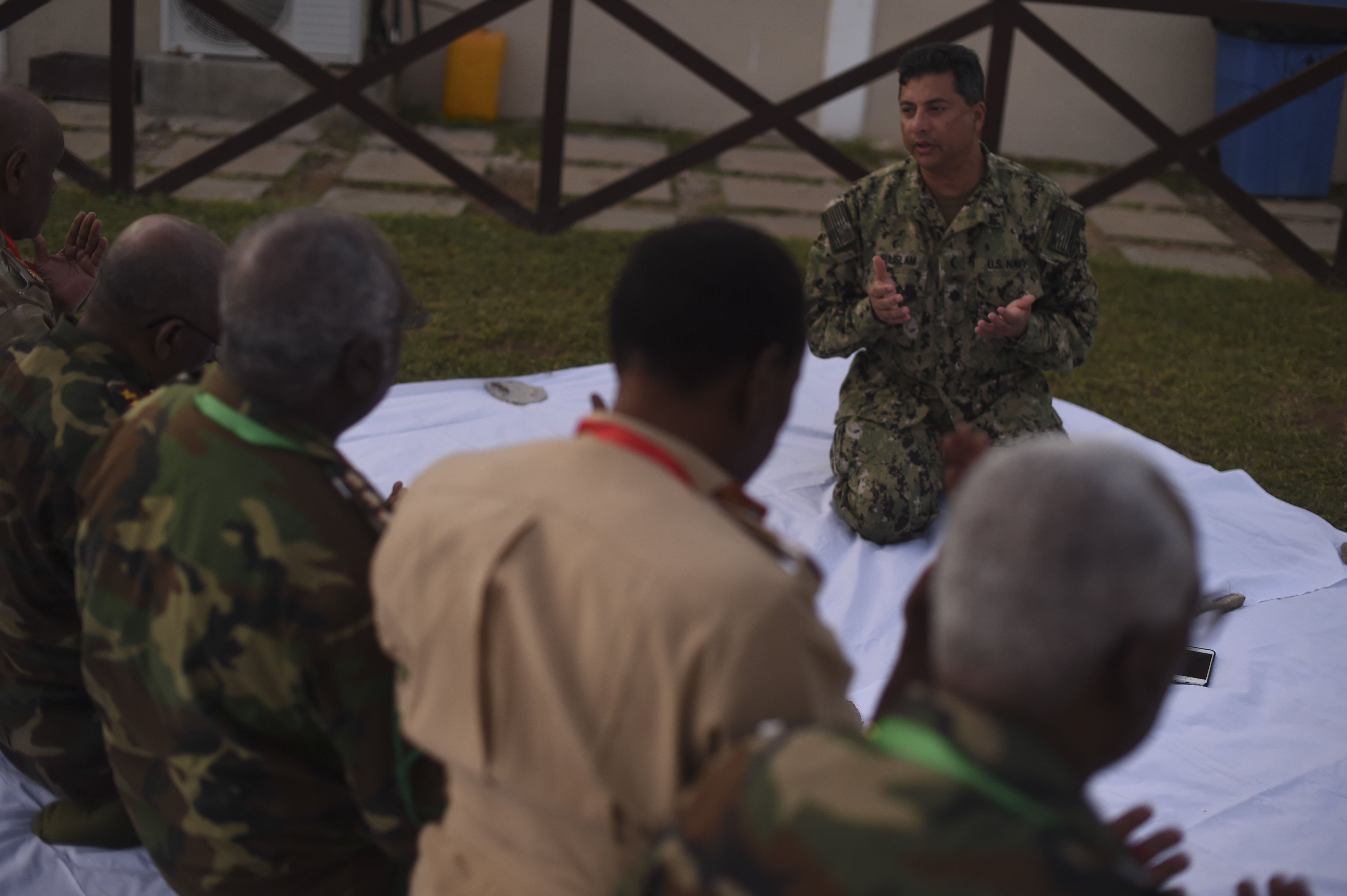 U.S. Navy Cmdr. Abuhena Saifulislam, U.S. Africa Command deputy command chaplain, speaks with members of the Somali National Army during a prayer before an Iftar at the Mogadishu International Airport, Mogadishu, Somalia, June 5, 2017. Saifulislam is the first Imam to be part of the AFRICOM Chaplain Corps and led the prayer that preceded the Iftar, which is the nightly meal that ends the day's fast during Ramadan. (U.S. Air Force Photo by Staff Sgt. Eboni Prince)