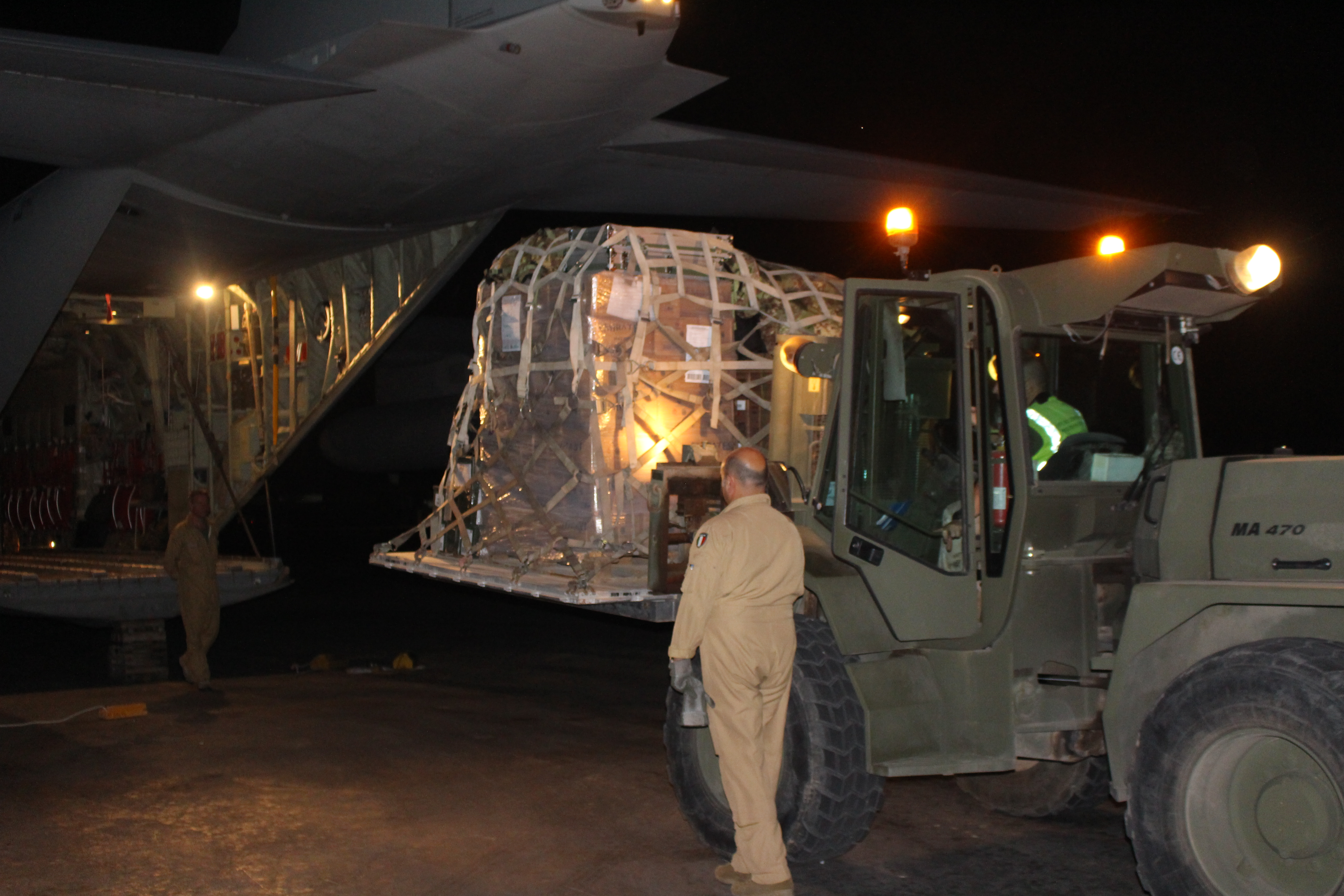 Members of the Italian Army load cargo for an Air Transportation and Refueling Exchange of Service (ATARES) proof-of-concept mission out of Djibouti, Africa, June 6, 2017. (Photo courtesy of Italian Army member Gennaro de Gennaro)