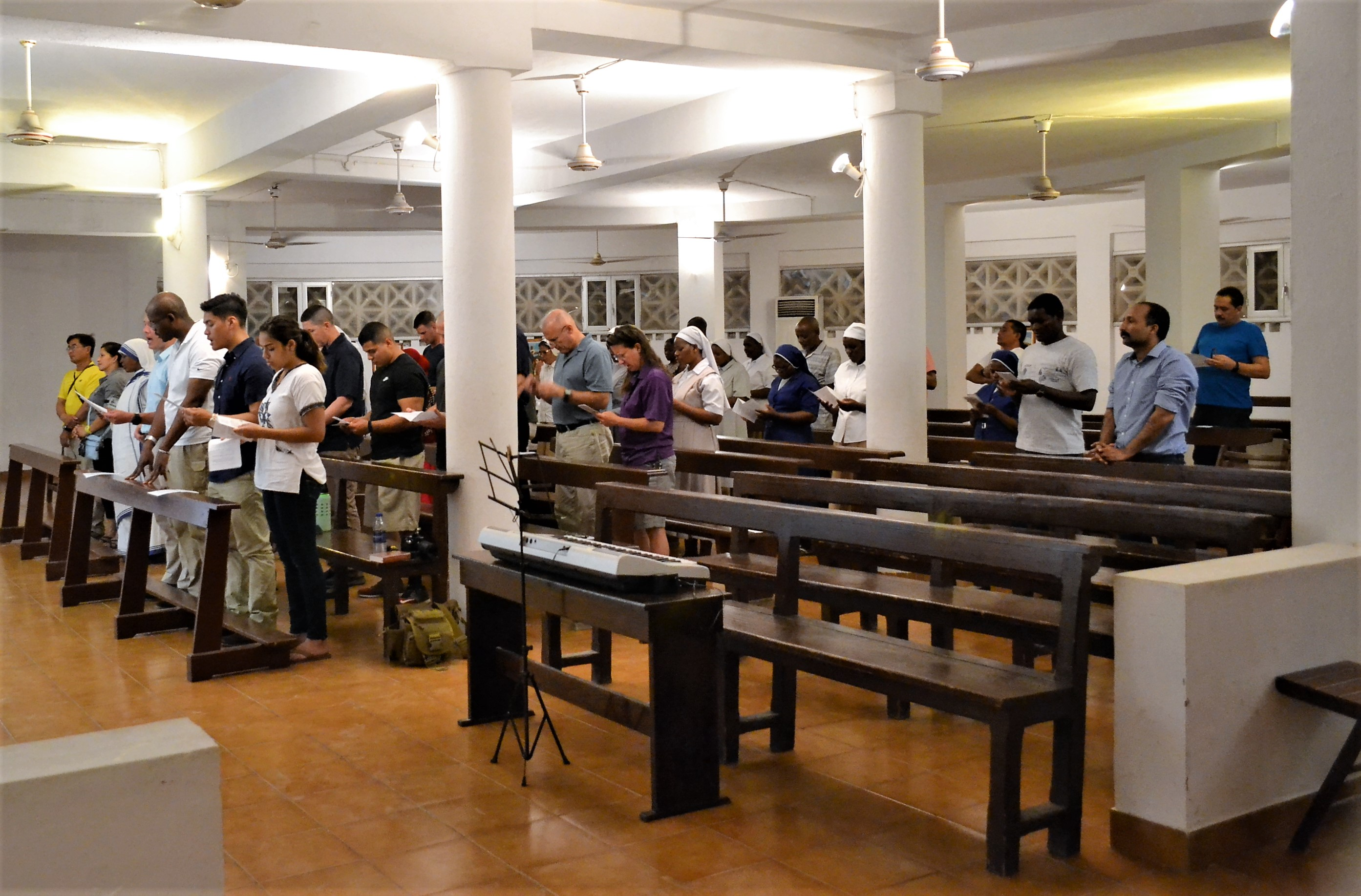 Camp Lemonnier-stationed Roman Catholics and their Djiboutian counterparts met iin faith, worshipping together inside the main Catholic church of Djibouti – Cathédrale Notre-Dame du Bon-Pasteur de Djibouti, known in English as Our Lady of the Good Shepherd Cathedral, June 15, 2017. Last month, the Combined Joint Task Force – Horn of Africa Religious Affairs Office began the mission of once again uniting the faithful in Djibouti's cathedral.(U.S. Air National Guard photo by Tech. Sgt. Andria Allmond)