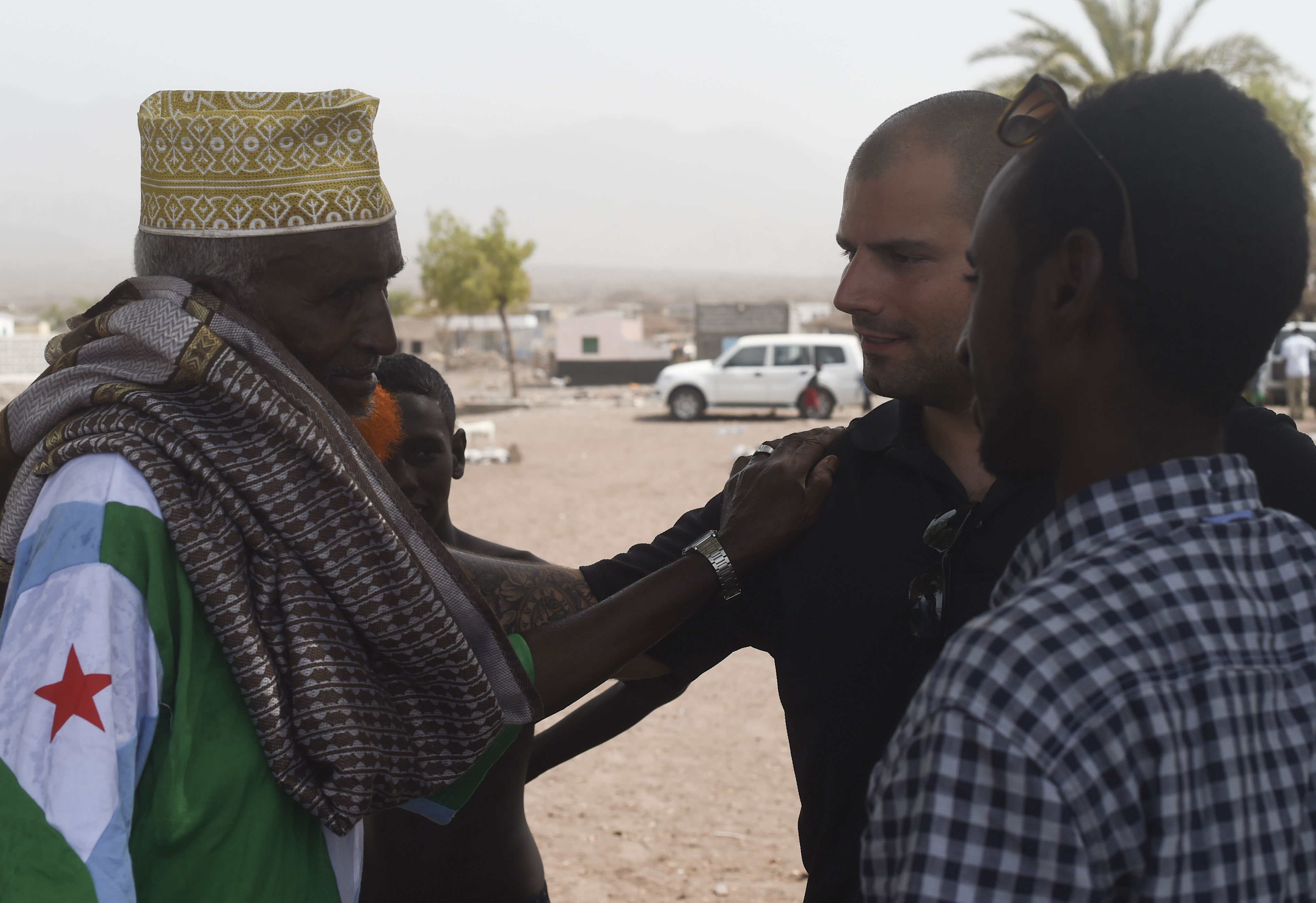 U.S. Army Staff Sgt. Frank Nordby, 411th Civil Affairs Battalion, Bravo Company, Civil Affairs Team 3, an associated unit of the Combined Joint Task Force-Horn of Africa, greets a village elder of Sagallou, Djibouti during a key leader engagement on June 28, 2017. These visits support CJTF-HOA's efforts to build positive relationships within the region and assist U.S. Africa Command in its efforts to promote regional security, stability and prosperity. (U.S. Air Force photo by Staff Sgt. Eboni Prince)
