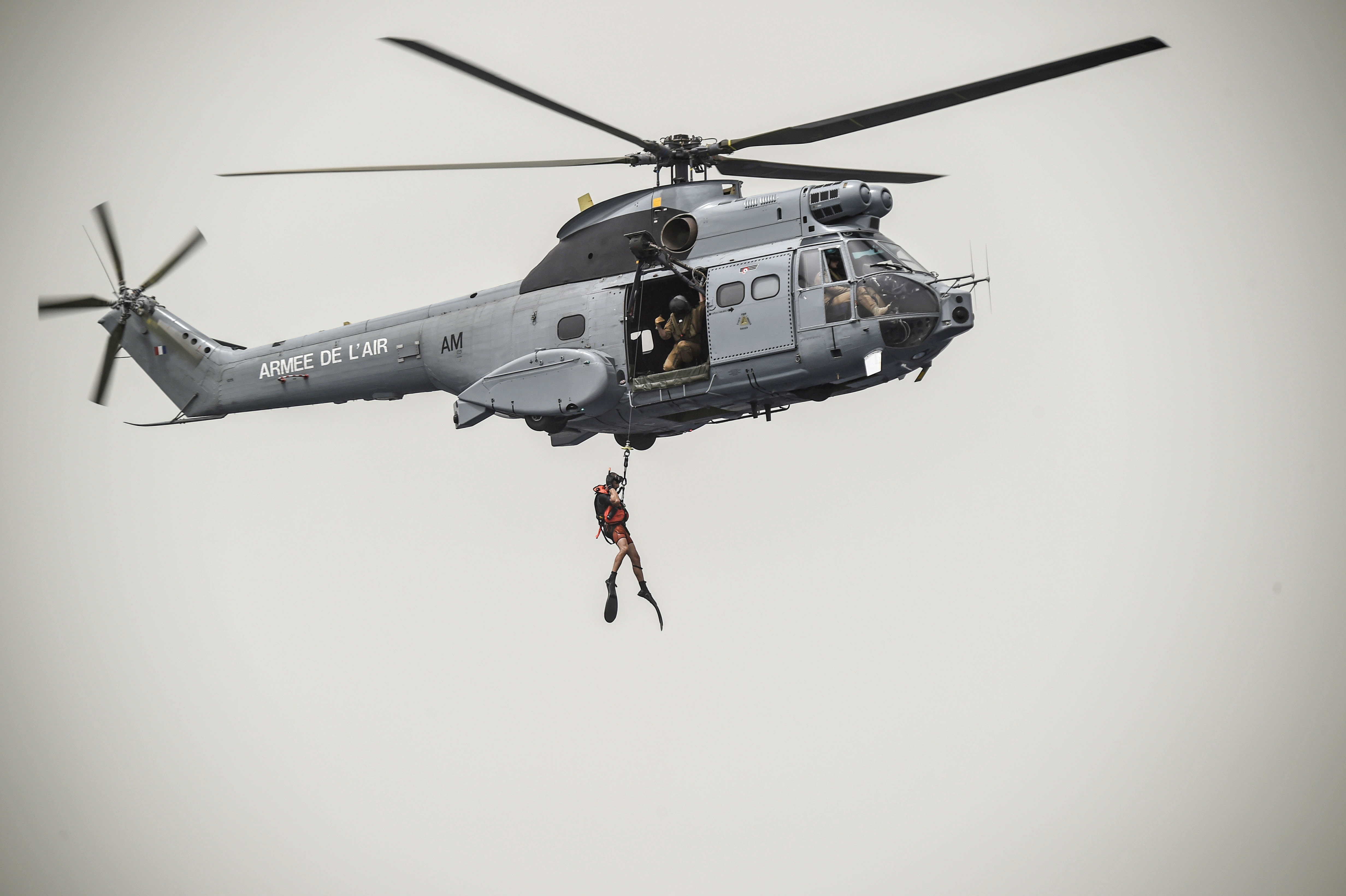 A French Air Force member assigned to the Transport Squadron ET 88 is hoisted from into a French Air Force Aérospatiale SA 330 Puma helicopter during a bilateral water operations exercise, in the Gulf of Tadjoura, July 3, 2017. The results of the exercise will aid in the development of standard operating procedures between CJTF-HOA and the French Forces stationed in Djibouti for the U.S. and France's mutual support of maritime rescue capabilities within the Horn of Africa region.  (U.S. Air Force photo by Staff Sgt. Eboni Prince)