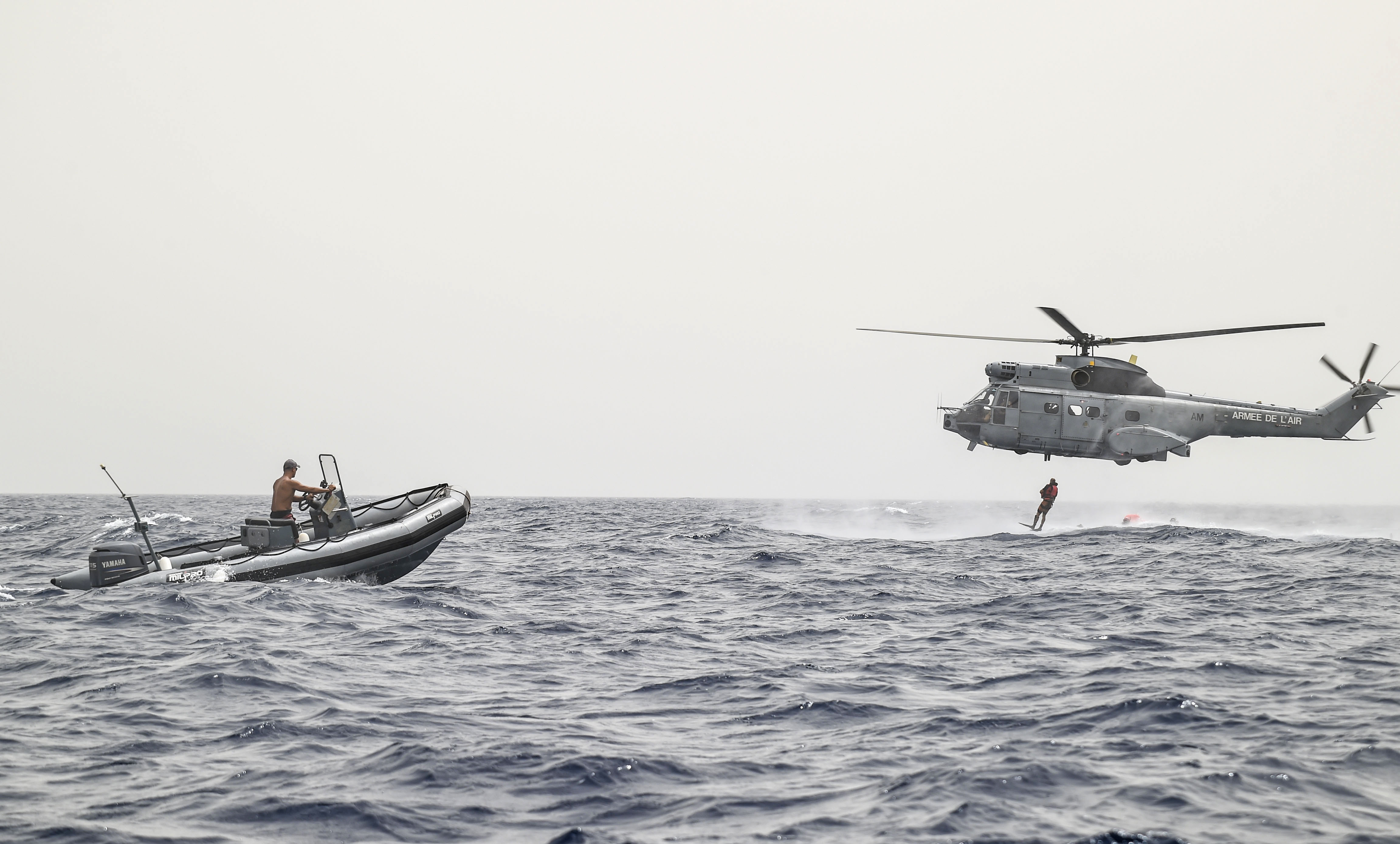 French Air Force rescue personnel assigned to the Transport Squadron ET 88 participate in a bilateral water operations exercise with pararescuemen from the 82nd Expeditionary Rescue Squadron, assigned to Combined Joint Task Force-Horn of Africa, in the Gulf of Tadjoura, July 3, 2017. The results of the exercise will aid in the development of standard operating procedures between CJTF-HOA and the French Forces stationed in Djibouti for the U.S. and France's mutual support of maritime  rescue capabilities within the Horn of Africa region. (U.S. Air Force photo by Staff Sgt. Eboni Prince)