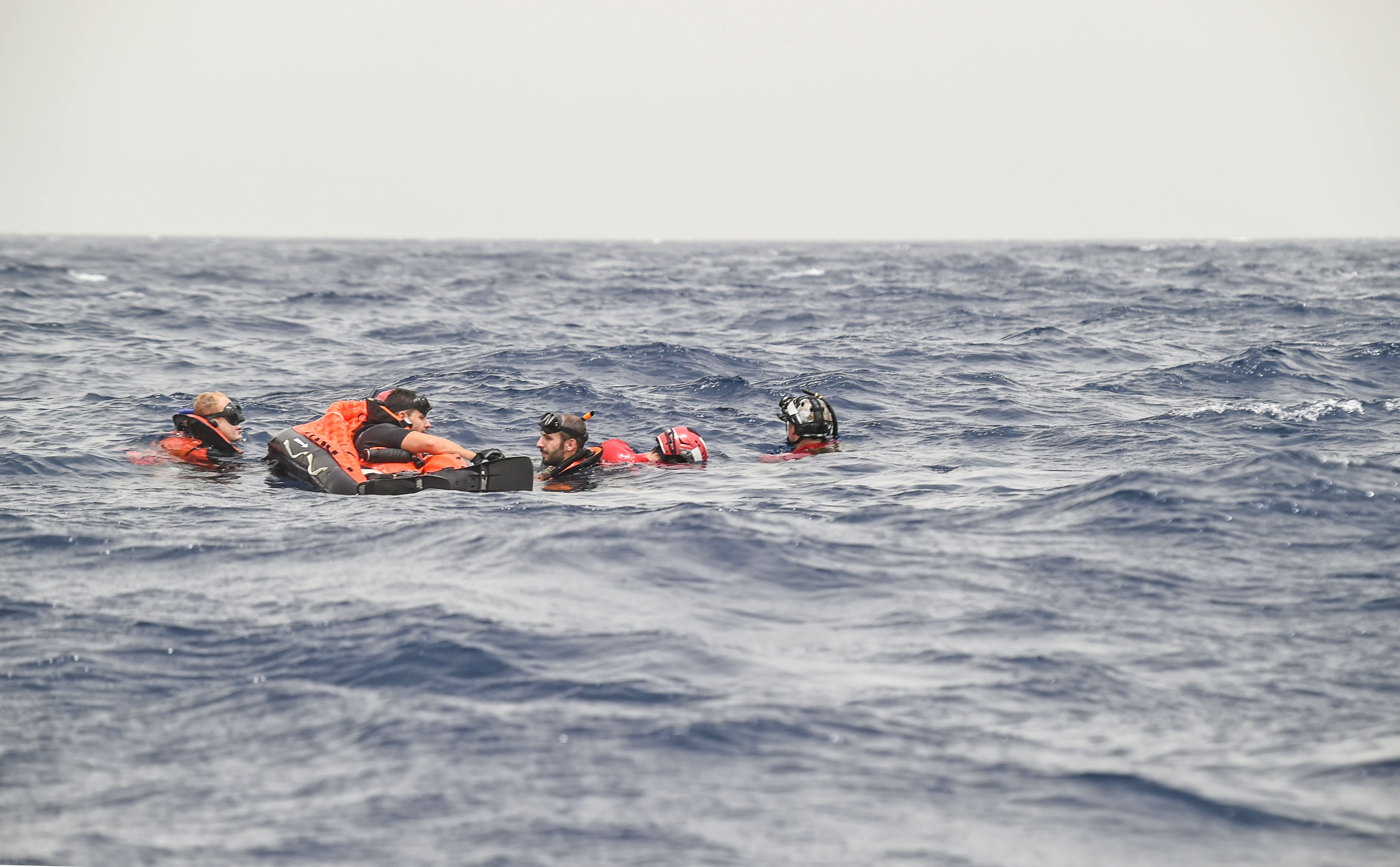 French Air Force rescue personnel assigned to the Transport Squadron ET 88 and U.S. Air Force pararescuemen from the 82nd Expeditionary Rescue Squadron, assigned to Combined Joint Task Force-Horn of Africa, participate in a bilateral water operations exercise, in the Gulf of Tadjoura, July 3, 2017. This exercise marked the first bilateral rotary wing water operations exercise between the 82 ERQS and French forces. (U.S. Air Force photo by Staff Sgt. Eboni Prince)