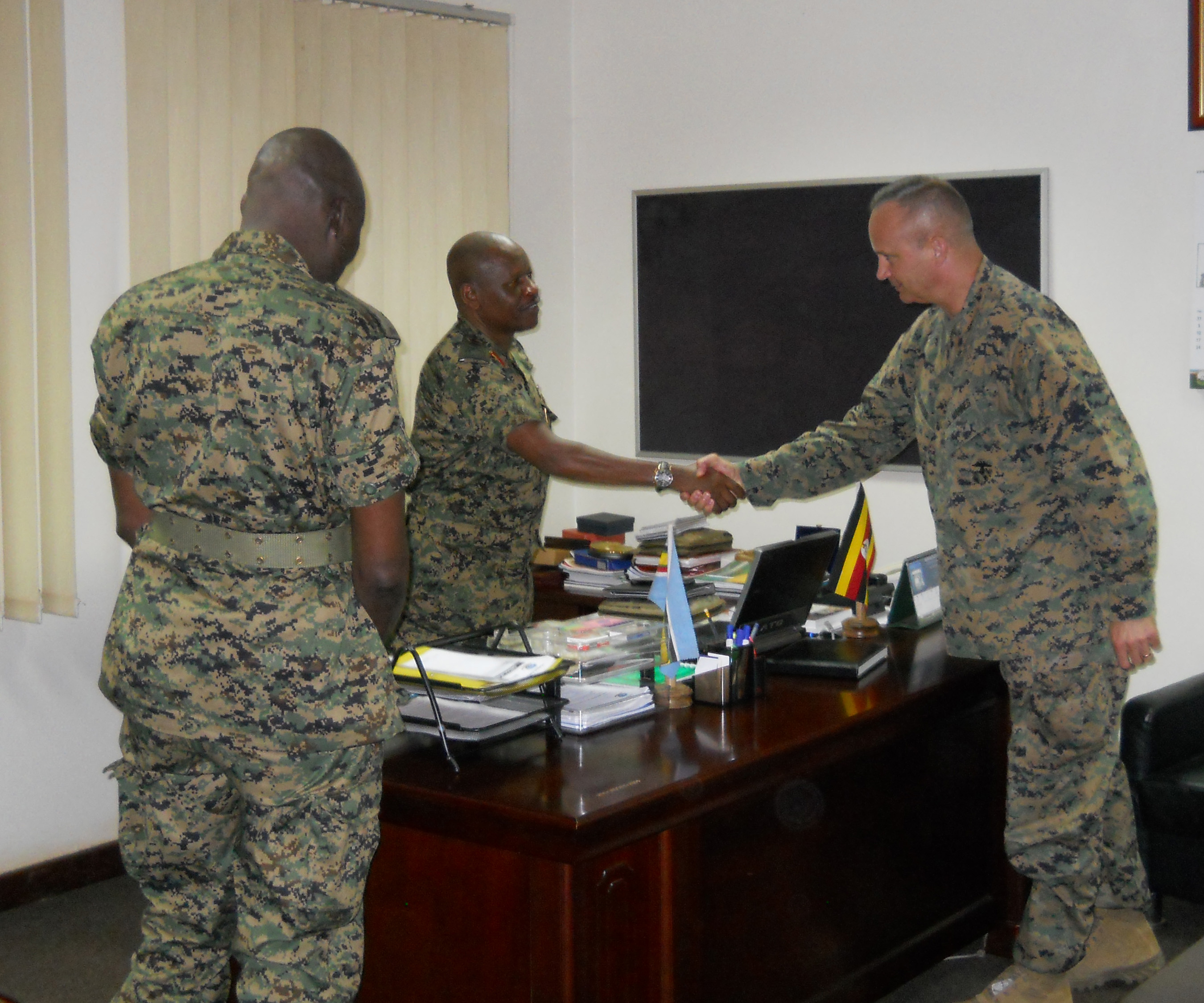 Lt. Gen. Wilson Mbadi, the Deputy Chief of Uganda People's Defense Force (middle) greets Combined Joint Task Force-Horn of Africa commander U.S. Marine Corps Brig. Gen. David Furness (right) for an office call during a recent visit to an historic UPDF engineering course graduation at the Uganda Rapid Deployment Capability Center, based in Jinja, Uganda. The two military leaders, along with Uganda Rapid Deployment Capability Center commandant Maj. Gen. James Nnkibus Lakara (far left) discussed shared interests, including partnership opportunities for future courses. In the latest iteration of the engineering course, UPDF trainers were advised by U.S. Marine Corps partners from the Special Purpose Marine Air-Ground Task Force-Crisis Response-Africa. (Courtesy photo by Uganda Army Lt. Col. Nelson Aheebwa)