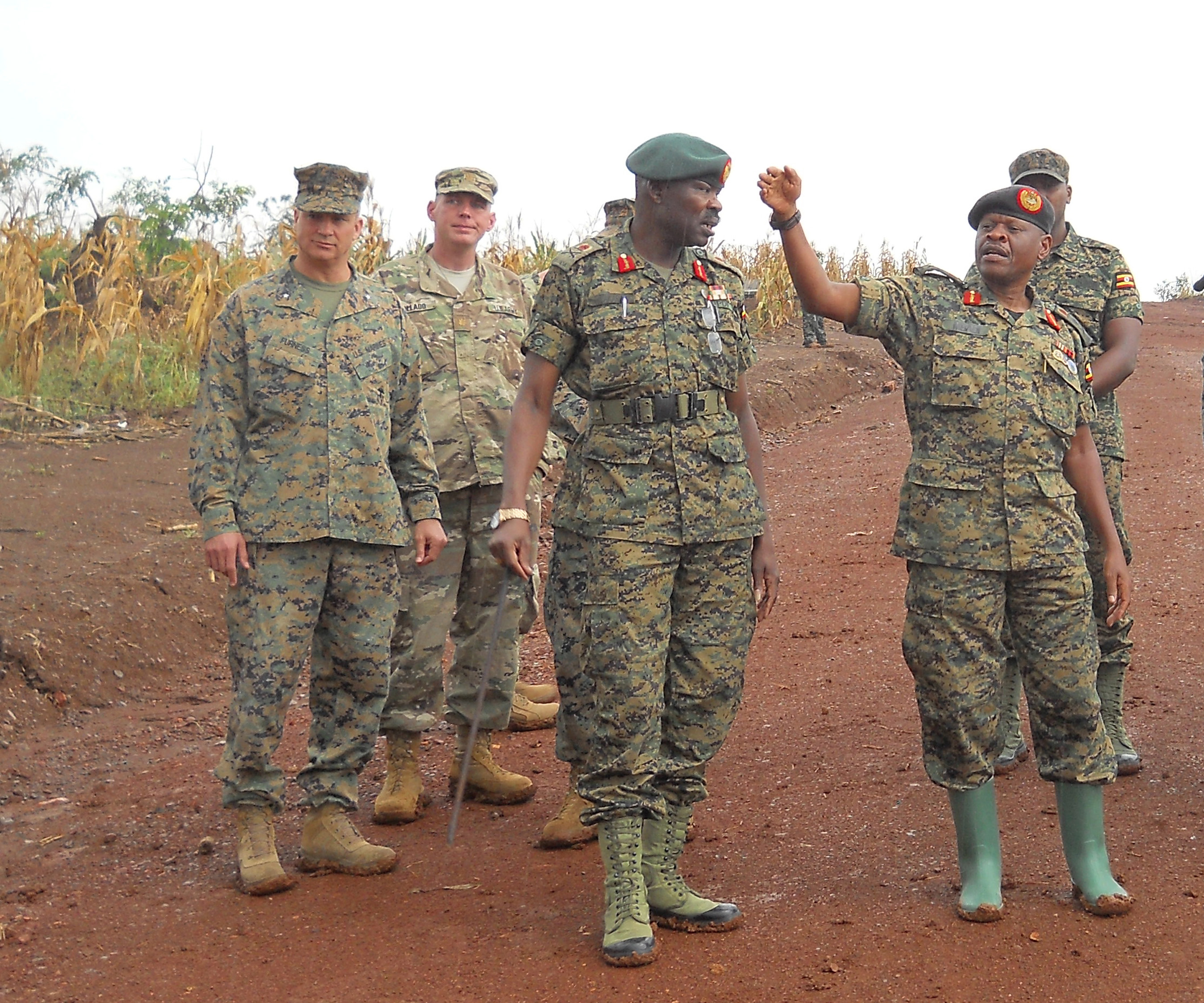 Lt. General Wilson Mbadi, the Deputy Chief of Uganda People's Defense Force (far right), gives Combined Joint Task Force-Horn of Africa commander U.S. Marine Corps Brig. Gen David Furness (far left) a tour of the Uganda Rapid Deployment Capability Center training location, based in Jinja, Uganda, July 7. The tour took place on the same day as an historic graduation of 60 UPDF engineers from Class 17.2, which marked the conclusion of the first class where UPDF instructors both ran and taught the entire course. Class 17.2's training took place at the Uganda Rapid Deployment Capability Center. (Courtesy photo by Uganda Army Lt. Col. Nelson Aheebwa)