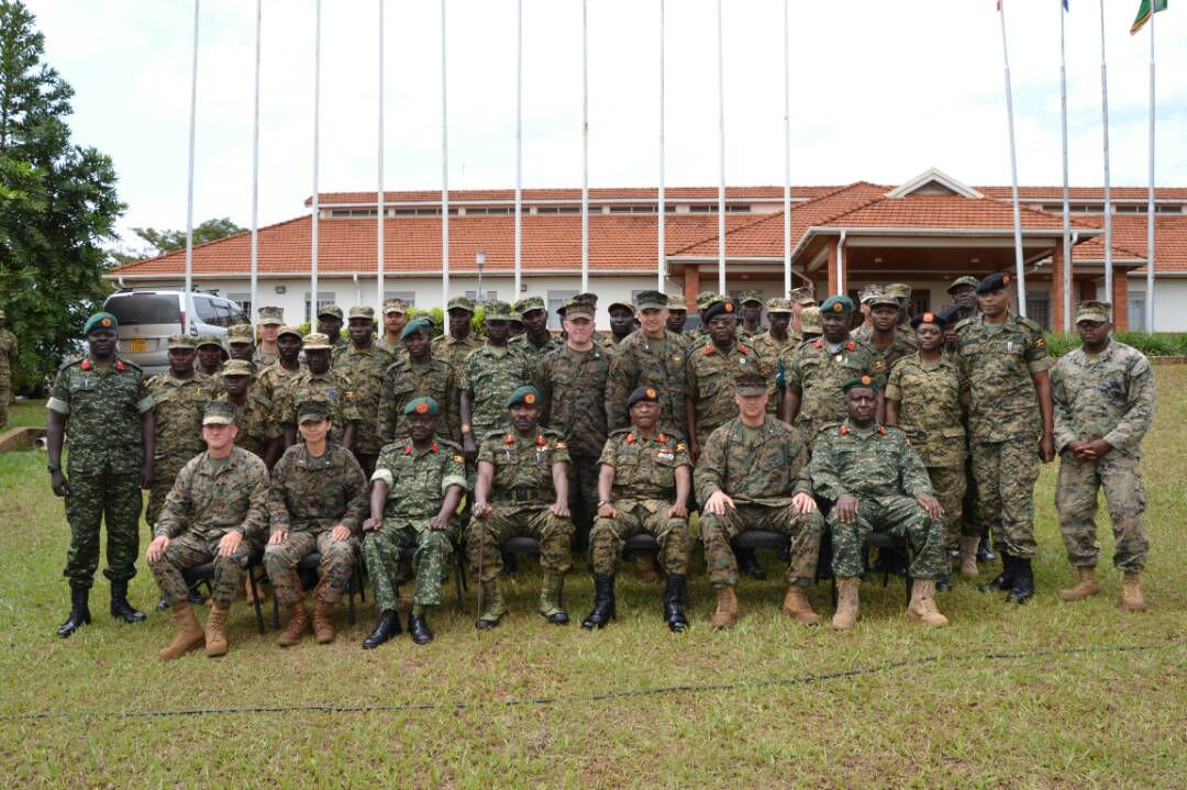 Combined Joint Task Force-Horn of Africa commander U.S. Marine Corps Brig. Gen. David Furness (seated, second from left) takes part in a group photo in a training center in Jinja, Uganda, with Uganda People's Defense Force leadership, staff and students, some of whom graduated July 7, 2017, from a two-month engineering course. The Class 17.2 graduation was historic because it marked the conclusion of the first class where UPDF instructors both ran and taught the entire course. (Courtesy photo by Uganda Army Lt. Col. Nelson Aheebwa)