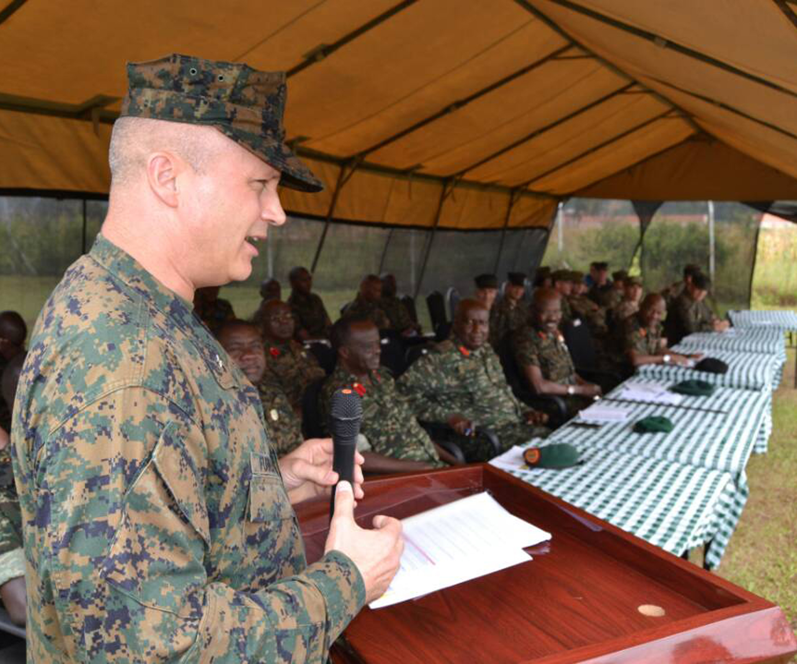 Combined Joint Task Force-Horn of Africa commander U.S. Marine Corps Brig. Gen. David Furness gives remarks to a crowd including Uganda People's Defense Force leadership, staff, as well as students who graduated July 7, 2017, from a two-month engineering course in Jinja, Uganda. The Class 17.2 graduation was historic because it marked the conclusion of the first class where UPDF instructors both ran and taught the entire course, advised by U.S. Marine Corps partners from the Special Purpose Marine Air-Ground Task Force-Crisis Response-Africa. The course covered three subjects, including civil engineering, heavy equipment operations and utilities management. (Courtesy photo by Uganda Army Lt. Col. Nelson Aheebwa)