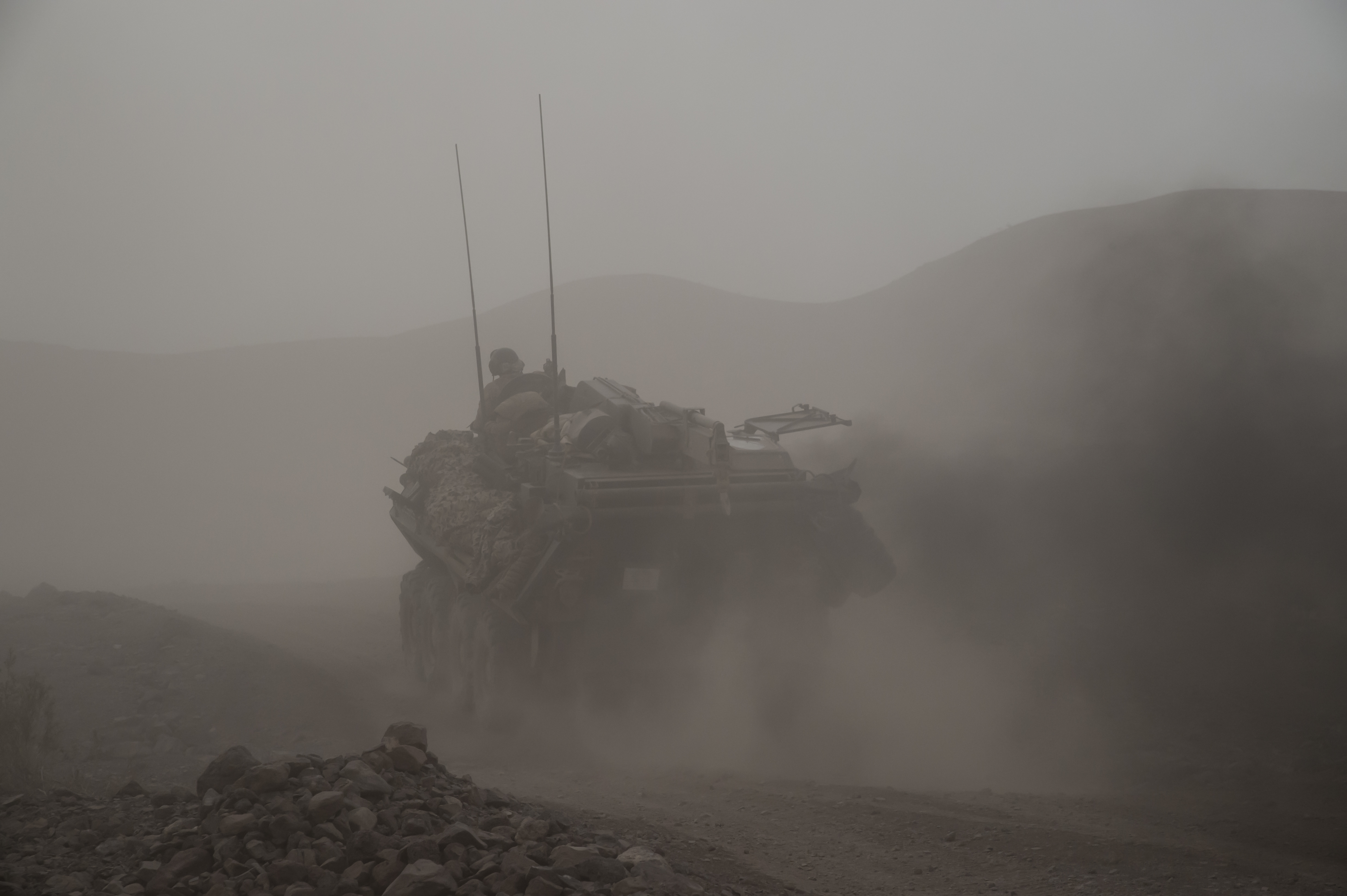 Marines with the 24th Marine Expeditionary Unit in an amphibious assault vehicle are dusted by an MV-22 Osprey during an exercise on the east coast of Africa from the amphibious assault ship USS Bataan (LHD 5) July 9, 2017. Marines with the 24th MEU conduct annual training while deployed with the Bataan Amphibious Ready Group to stay mission ready and maintain Marine Corps standards. Bataan and its ARG are deployed to the U.S. 5th Fleet area of operations in support of maritime security operations designed to reassure allies and partners and preserve the freedom of navigation and the free flow of commerce in the region. (U.S. Air National Guard photo by Tech. Sgt. Joe Harwood)