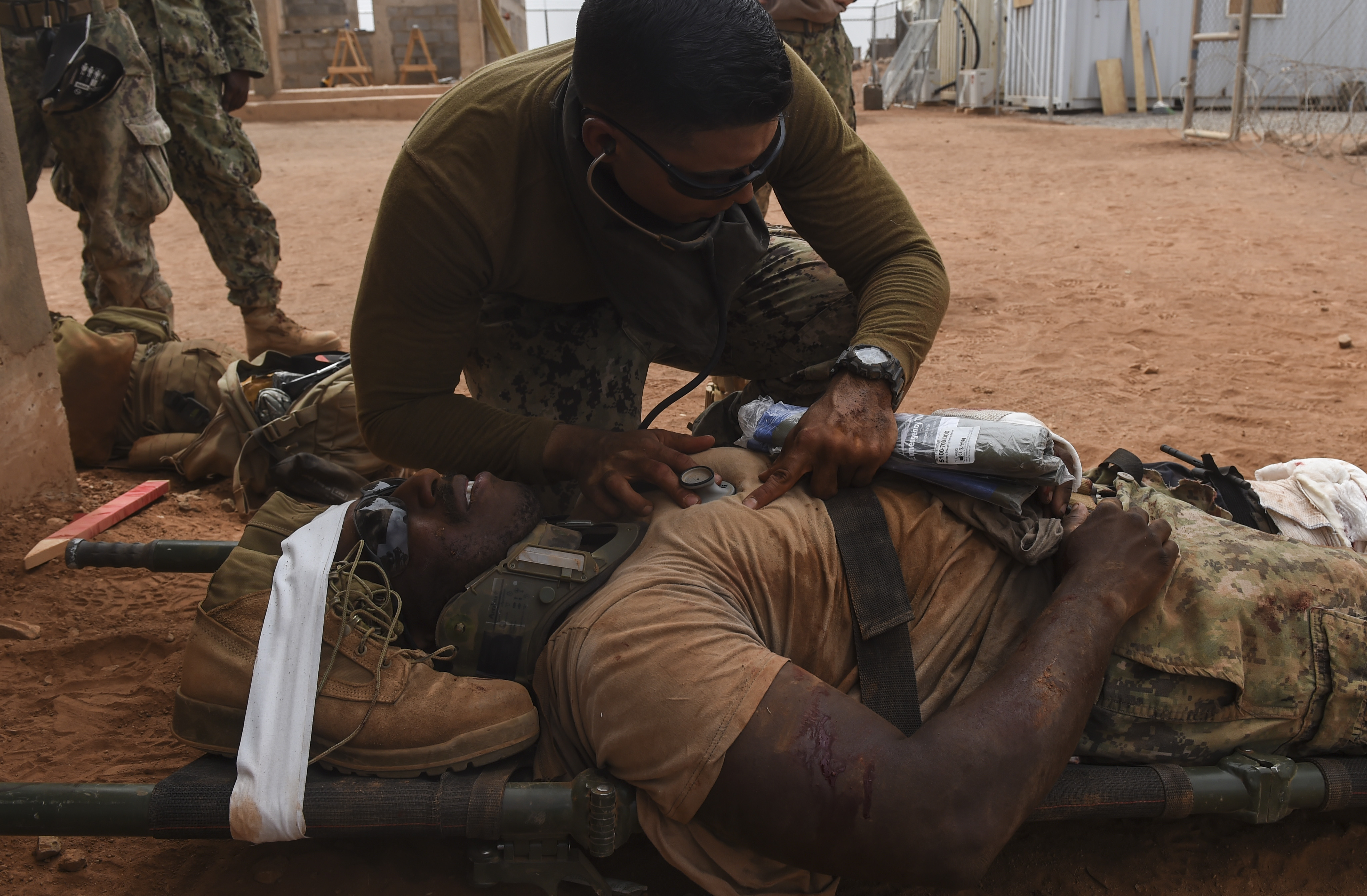 U.S. Navy Hospital Corpsman 3rd Class David Rojas from the Naval Mobile Construction Battalion One, a maneuver unit of the Combined Joint Task Force-Horn of Africa, uses a stethoscope to listen to a patient's heartbeat during a bilateral exercise with French forces in the Arta region, July 19, 2017. This bilateral training was the first execution of medical evacuation procedures with French military personnel and increases the ability of all participants to plan, communicate and execute complex operations. (U.S. Air Force photo by Staff Sgt. Eboni Prince)