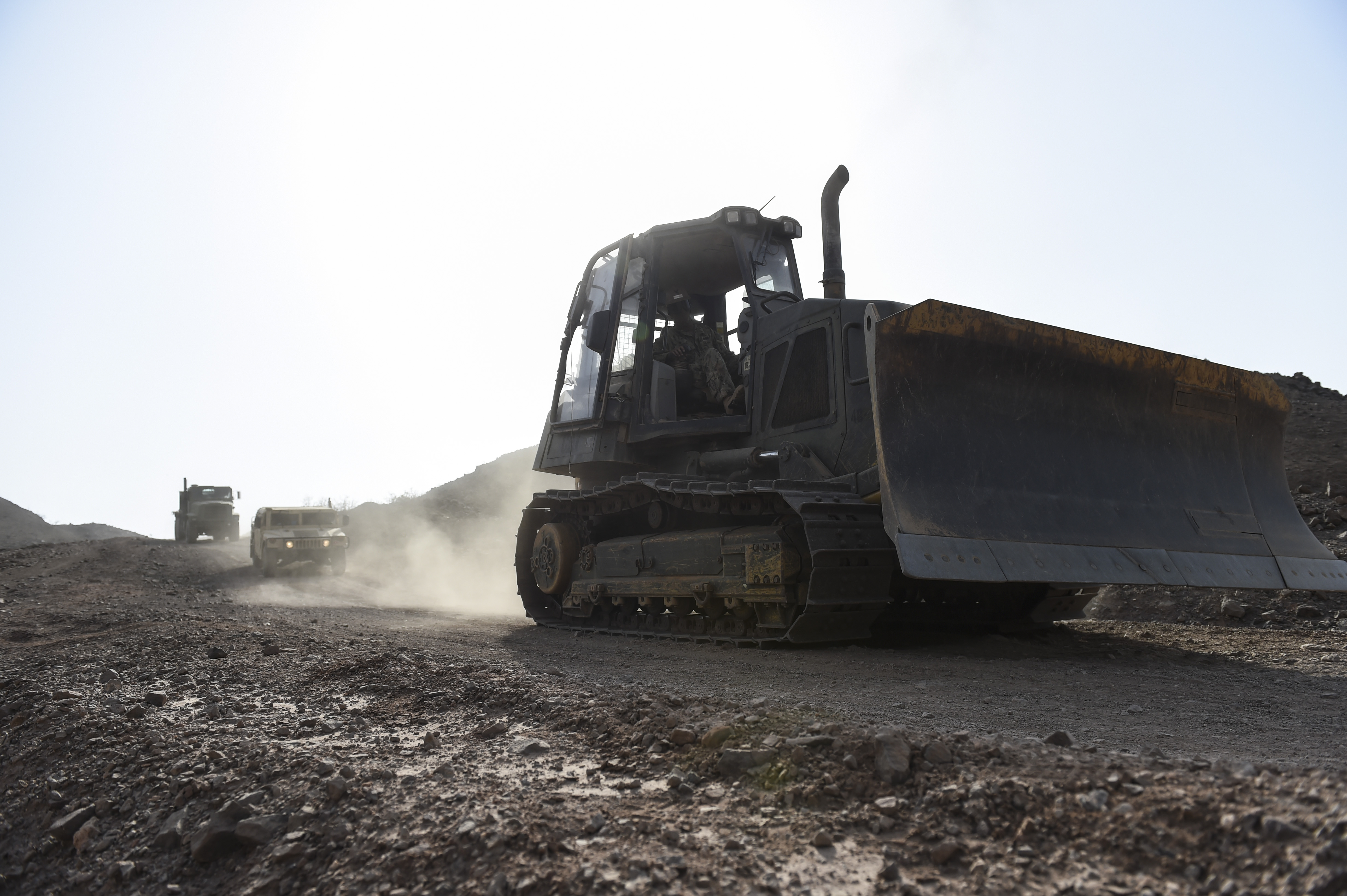 A convoy of construction vehicles navigate through a range near Arta, Djibouti, July 28, 2017. Members of the U.S. Naval Mobile Construction Battalion One completed a project to improve and develop the roadways. NMCB One supports Combined Joint Task Force-Horn of Africa through the completion various construction projects throughout East Africa that aid promoting stability in the region. (U.S. Air Force photo by Staff Sgt. Eboni Prince)