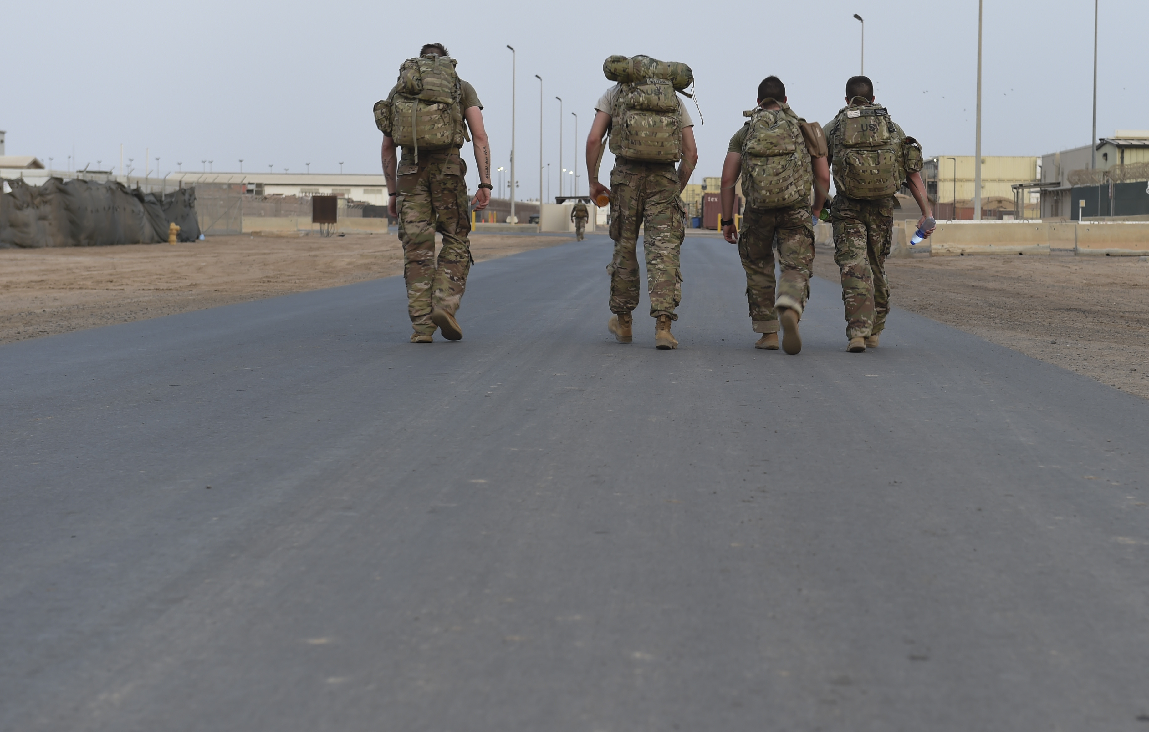 U.S. military members participate in a ruck march during a physical training test at Camp Lemonnier, Djibouti, Aug. 5, 2017. The test was in preparation for an upcoming multi-day French Desert Commando Course that will challenge participants physically and mentally through land and water obstacles, combat scenarios and extreme endurance exercises while surviving in austere field conditions. (U.S. Air Force photo by Staff Sgt. Eboni Prince)