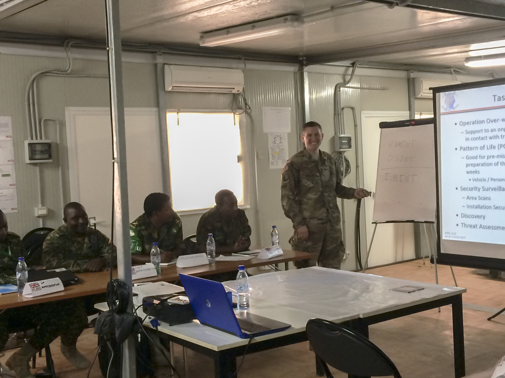 U.S. Air Force Capt. Brian Hurt, Combined Joint Task Force-Horn of Africa Intelligence Directorate collection manager, instructs a class during an intelligence, surveillance and reconnaissance (ISR) course in Mogadishu, Somalia, Aug. 7, 2017. Soldiers from five countries supporting African Union Mission in Somalia are taking the British-led ISR course to improve their intelligence-gathering capabilities in the fight against violent extremist organizations like al-Shabaab in East Africa. (Photo courtesy U.S. Air Force Capt. Brian Hurt/Released)