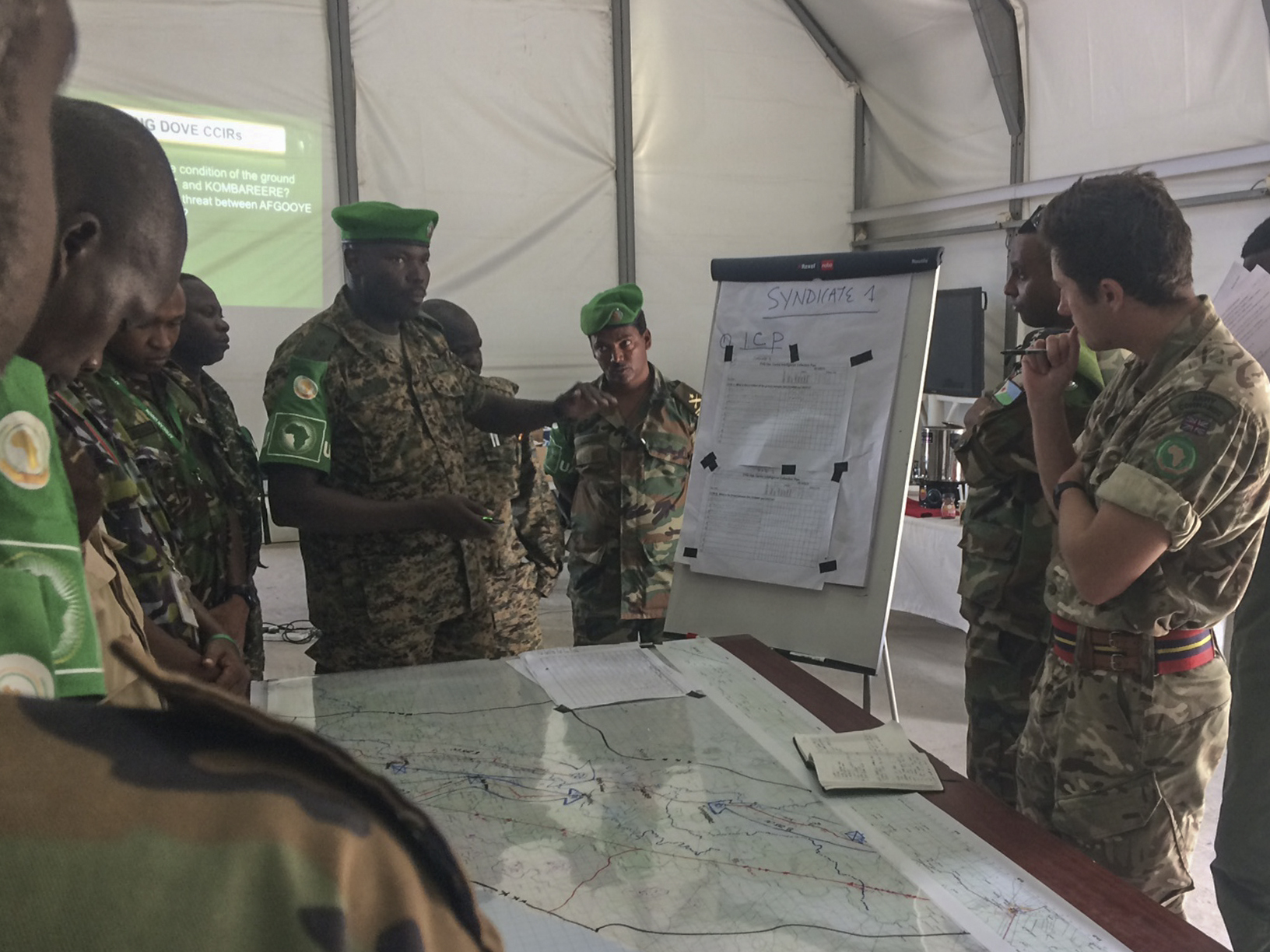 British Army Capt. Doug Collett (far right), U.K. Mission Support Team member, gives instruction during an intelligence, surveillance and reconnaissance (ISR) course in Mogadishu, Somalia, Aug. 7, 2017. Soldiers from five countries supporting African Union Mission in Somalia are taking the British-led ISR course to improve their intelligence-gathering capabilities in the fight against violent extremist organizations like al-Shabaab in East Africa. (Photo courtesy U.S. Air Force Capt. Brian Hurt/Released)