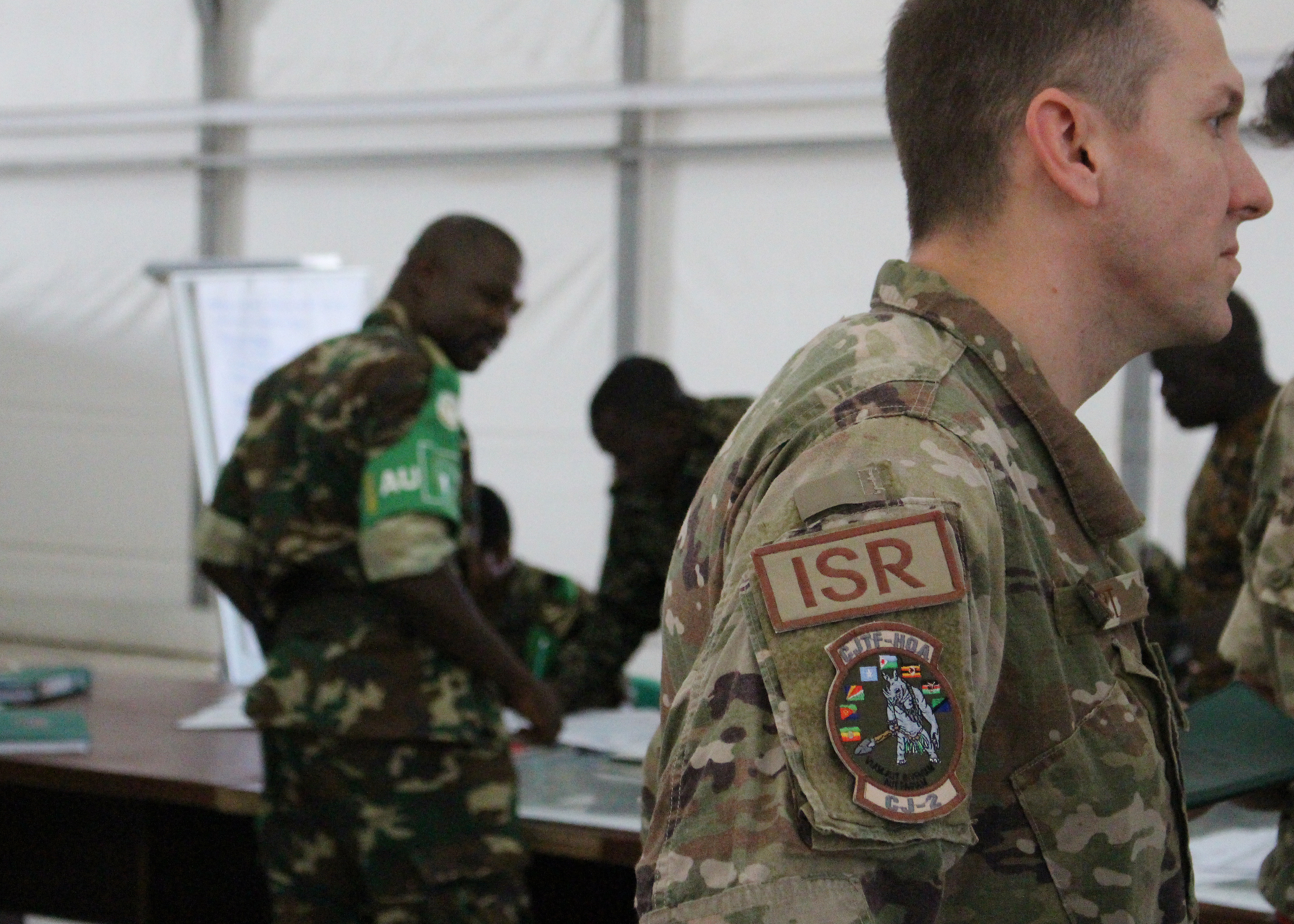 U.S. Air Force Capt. Brian Hurt, Combined Joint Task Force-Horn of Africa Intelligence Directorate collection manager, advises and assist during an intelligence, surveillance and reconnaissance (ISR) course in Mogadishu, Somalia, Aug. 7, 2017. Soldiers from five countries supporting the African Union Mission in Somalia are taking the British-led ISR course to strengthen efforts countering violent extremist organizations like al-Shabaab within East Africa. (Photo courtesy U.S. Air Force Capt. Brian Hurt/Released)