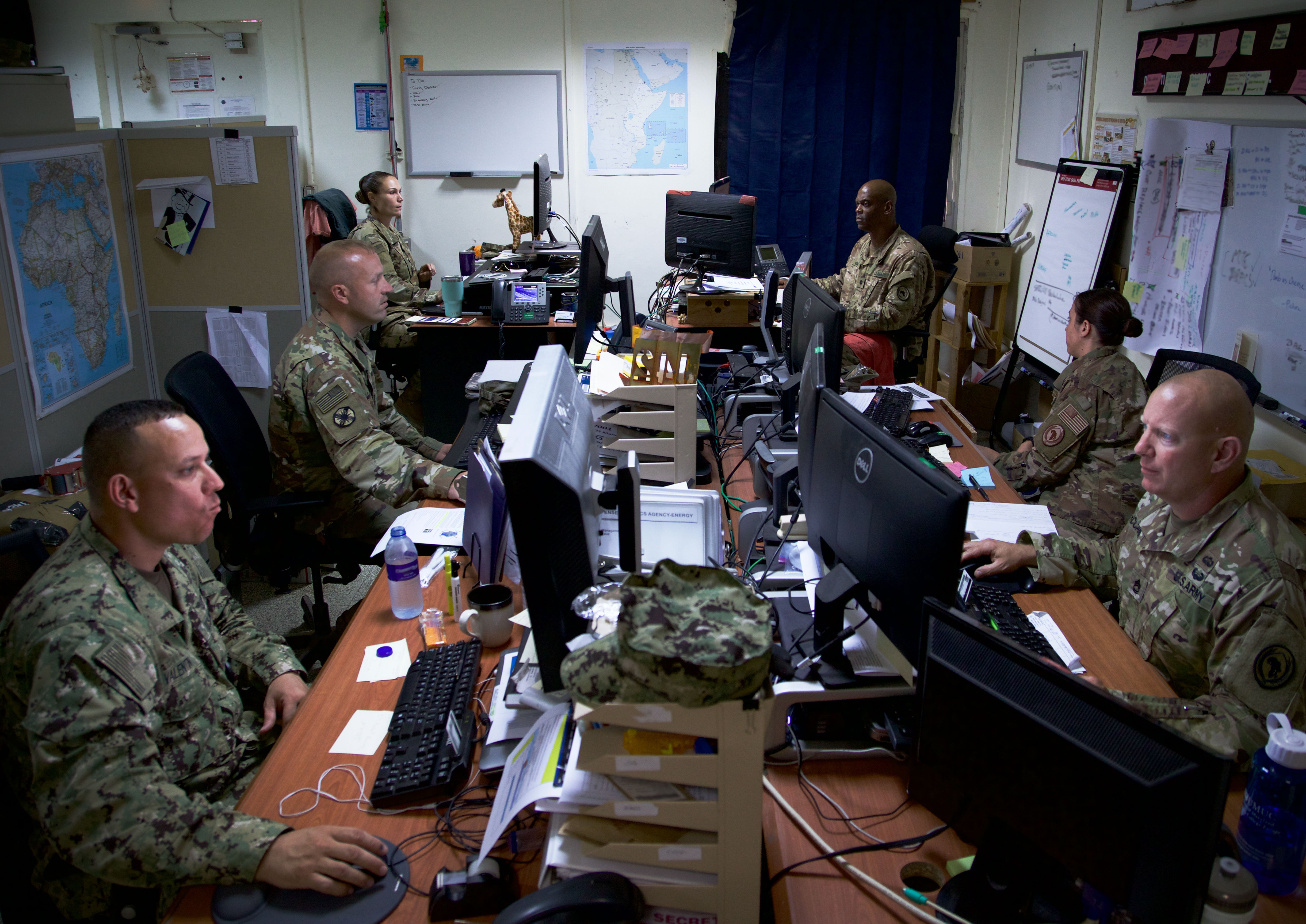 Members of the Combined Joint Task Force-Horn of Africa Logistics Directorate's Base Operating Support-Integrator office coordinate support resources at Camp Lemonnier, Djibouti, August 18, 2017. U.S. Africa Command designated CJTF-HOA as BOS-I in August 2016, putting the 500-person task force in charge of coordinating the efficient use of mission resources to sustain U.S. forces in forward operating locations in Somalia. Currently, CJTF-HOA's main effort is to improve security in Somalia by neutralizing violent extremist organizations like al-Shabaab and successfully transitioning security responsibilities from the African Union Mission in Somalia to the Somali National Security Forces. (U.S. Army photo by Capt. Alán Ortiz)