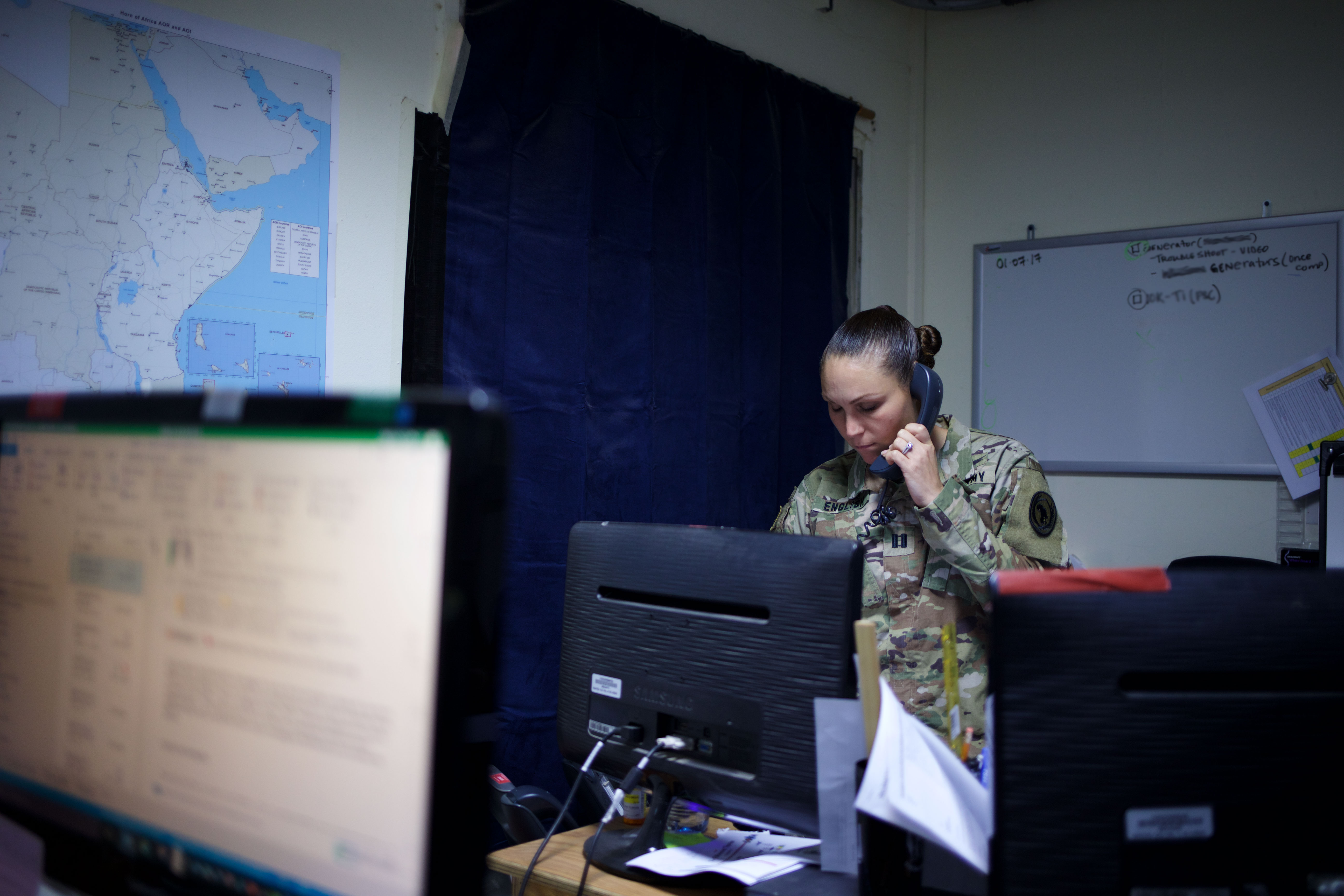 U.S. Army Capt. Amber English, a logistics officer with the Combined Joint Task Force-Horn of Africa Logistics Directorate's Base Operating Support-Integrator office, coordinates support resources at Camp Lemonnier, Djibouti, August 18, 2017. U.S. Africa Command designated CJTF-HOA as BOS-I in August 2016, putting the 500-person task force in charge of coordinating the efficient use of mission resources to sustain U.S. forces in forward operating locations in Somalia. Currently, CJTF-HOA's main effort is to improve security in Somalia by neutralizing violent extremist organizations like al-Shabaab and successfully transitioning security responsibilities from the African Union Mission in Somalia to the Somali National Security Forces. (U.S. Army photo by Capt. Alán Ortiz)