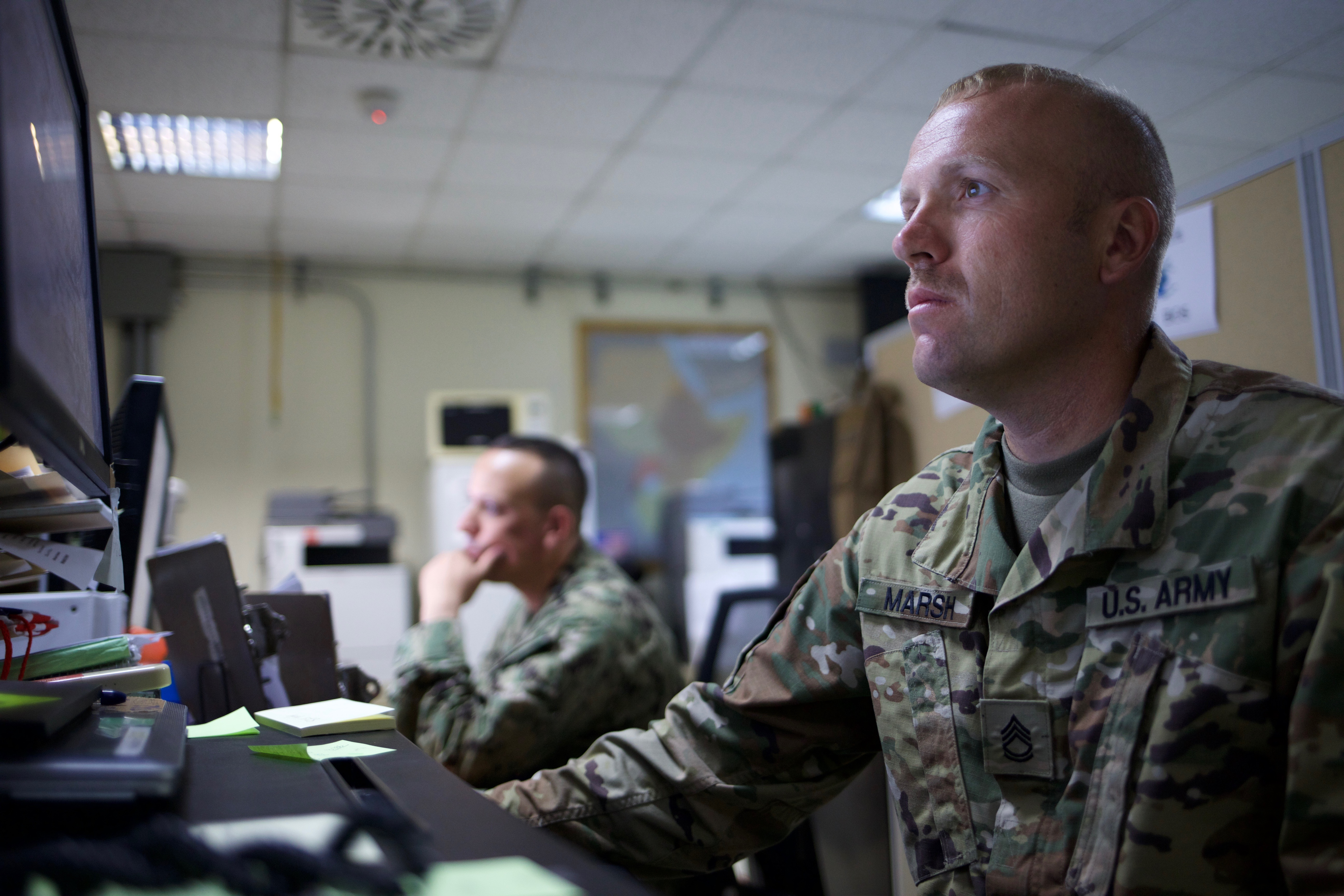 U.S. Army Sgt. 1st Class James Marsh, Base Operating Support manager with the Combined Joint Task Force-Horn of Africa Logistics Directorate's Base Operating Support-Integrator office, coordinates support resources at Camp Lemonnier, Djibouti, August 18, 2017. U.S. Africa Command designated CJTF-HOA as BOS-I in August 2016, putting the 500-person task force in charge of coordinating the efficient use of mission resources to sustain U.S. forces in forward operating locations in Somalia. Currently, CJTF-HOA's main effort is to improve security in Somalia by neutralizing violent extremist organizations like al-Shabaab and successfully transitioning security responsibilities from the African Union Mission in Somalia to the Somali National Security Forces. (U.S. Army photo by Capt. Alán Ortiz)