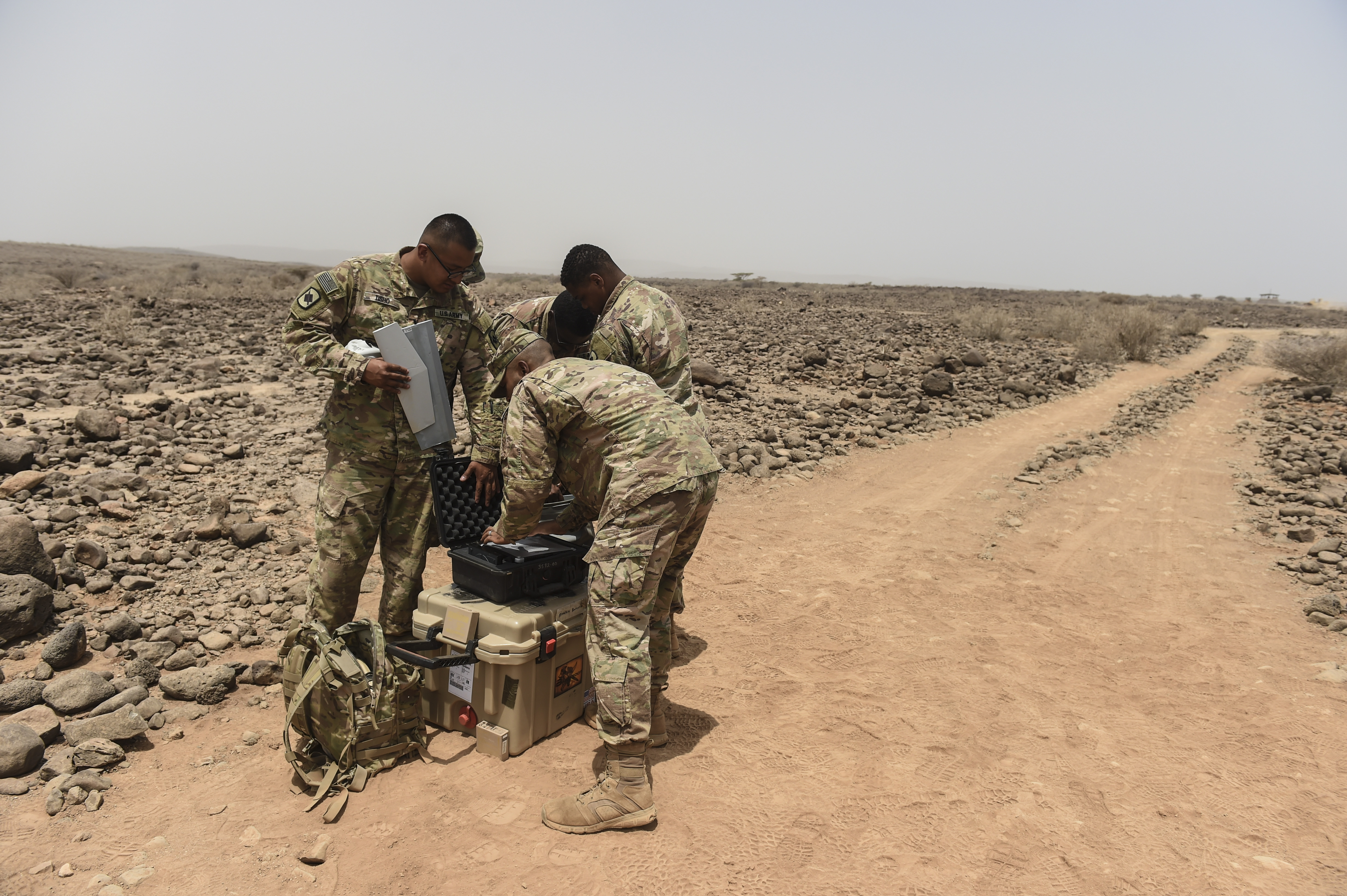 U.S. Army Soldiers assigned to the 1st Battalion, 153rd Infantry Regiment Task Force Warrior, an associated unit of Combined Joint Task Force - Horn of Africa, disassemble a Raven RQ-11 system during a demonstration in an airfield in southern Djibouti, Aug. 21, 2017. The demonstration was an effort to familiarize Djiboutian Armed Forces members with the unmanned aerial vehicle system, clear up confusion about the Raven RQ-11 and other RPAs, and show the safe operation of the Raven. (U.S. Air Force photo by Staff Sgt. Eboni Prince)