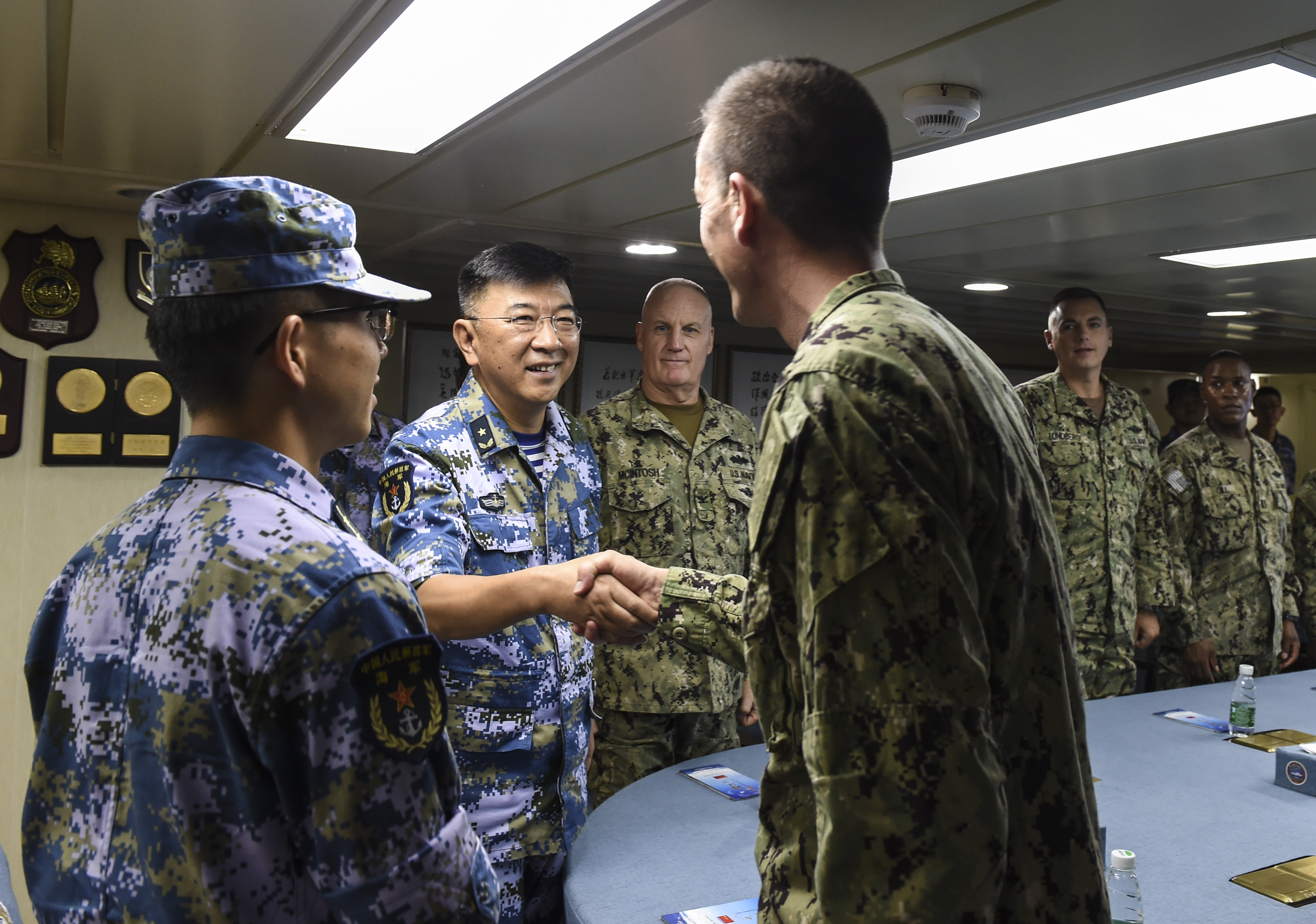 U.S. Navy Capt. Ian Branum, Combined Joint Task Force-Horn of Africa chief of staff shakes hands with Rear Admiral Guan Bolin, mission commander of China's hospital ship, Ark Peace, in the Port of Djibouti, August 28, 2017. Medical personnel from Camp Lemonnier visited the Ark Peace and received a tour from Chinese medical personnel to highlight the ship's capabilities. (U.S. Air Force photo by Staff Sgt. Eboni Prince)
