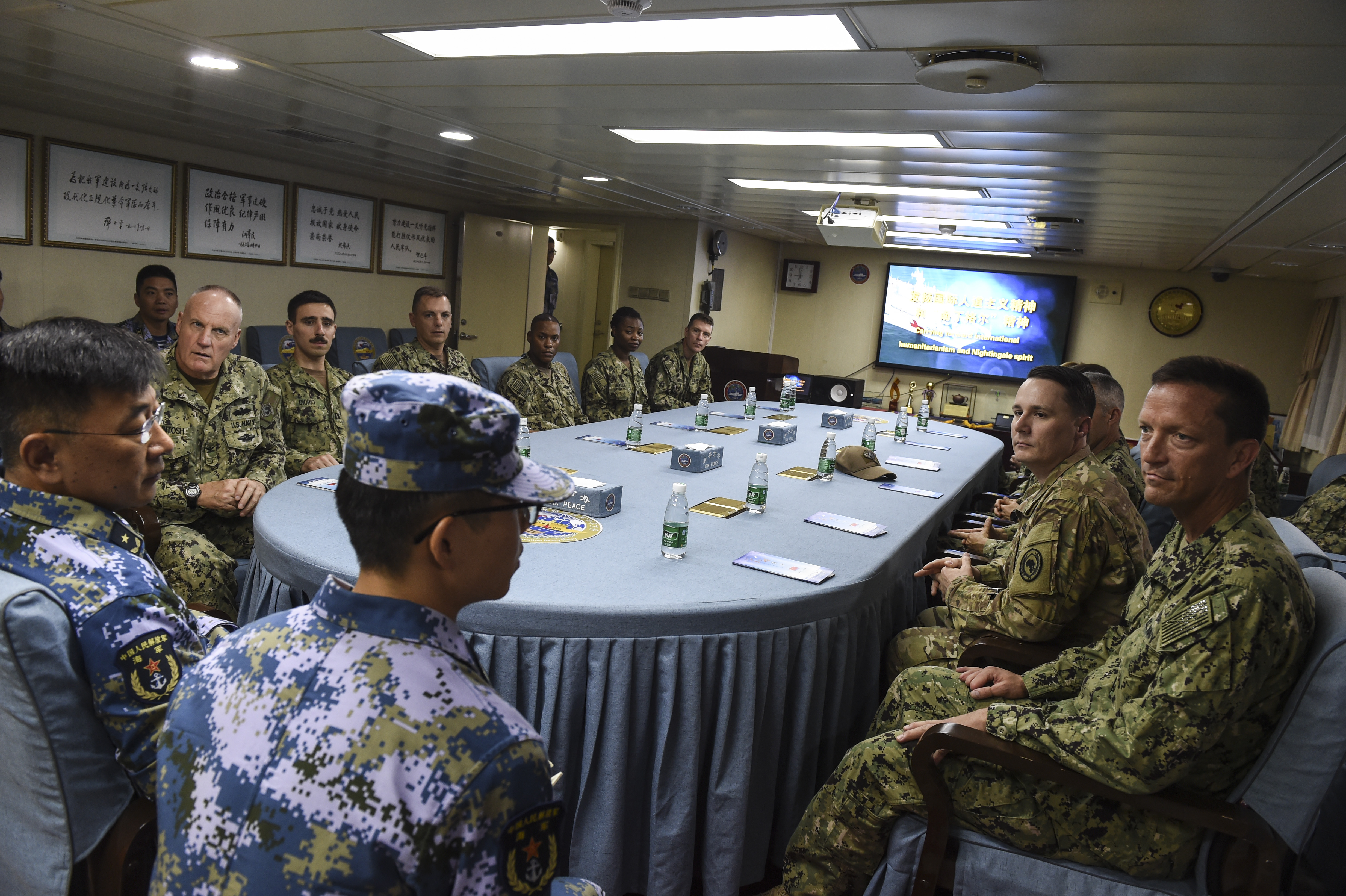 U.S. service members assigned to Camp Lemonnier met with Rear Admiral Guan Bolin, mission commander of China's hospital ship, Ark Peace, in the Port of Djibouti, August 28, 2017. Medical personnel from Camp Lemonnier visited the Ark Peace and received a tour from Chinese medical personnel to highlight the ship's capabilities. (U.S. Air Force photo by Staff Sgt. Eboni Prince)