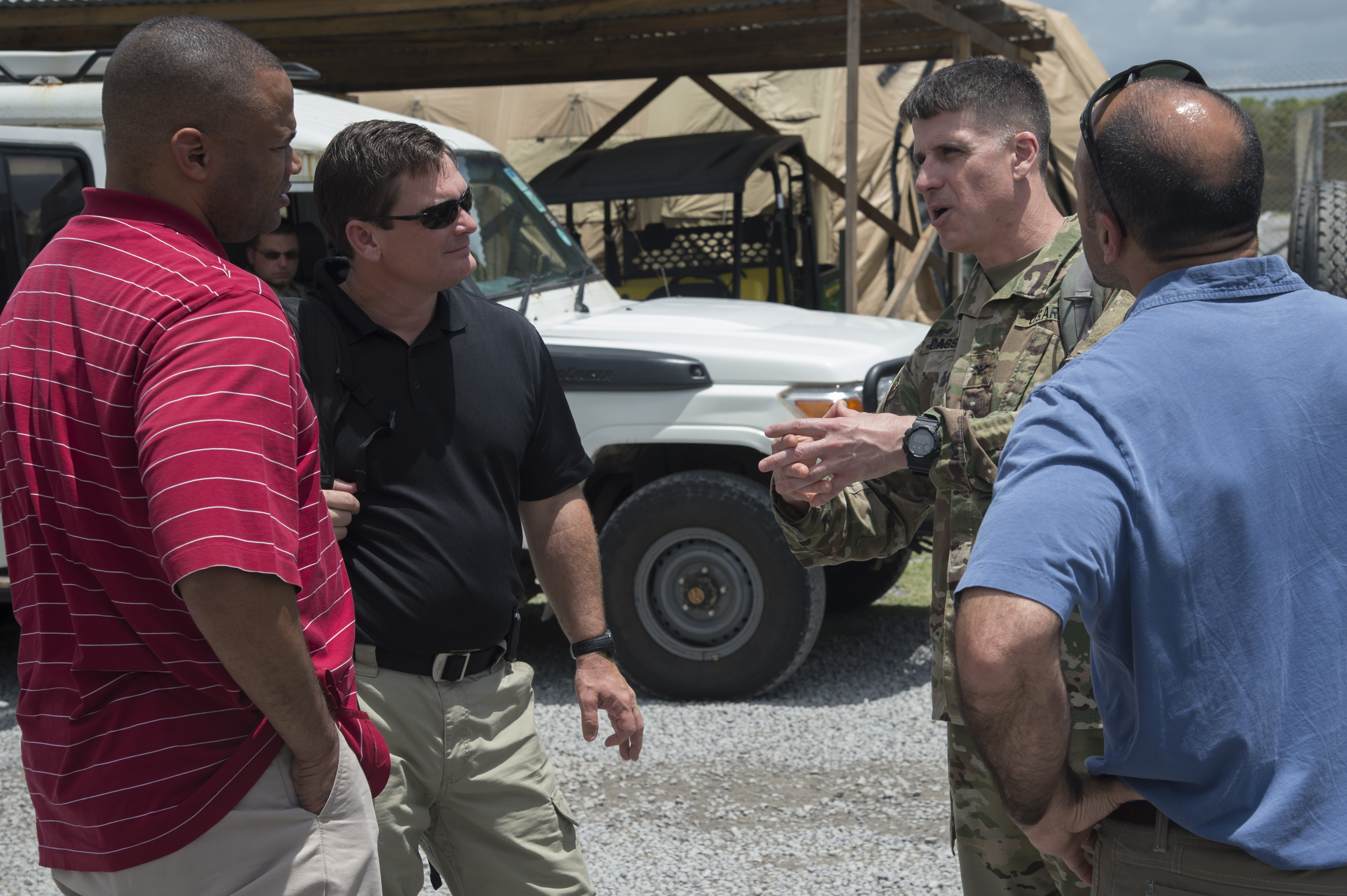 U.S. Army Col. Christopher Cassibry, director of operations for Combined Joint Task Force - Horn of Africa, speaks with members of a congressional delegation (CODEL) as they visited various locations within the CJTF-HOA area of responsibility on Aug. 27, 2017. The CODEL stayed three days at Camp Lemonnier, Djibouti, and from there traveled to various forward operating locations to meet U.S. service members and learn more about the U.S. military mission in East Africa. The CODEL included the following congressmen, all of whom are on the House Armed Service Committee; Rep. Austin Scott (R-Ga.) representing the 8th District of Georgia; Rep. Jimmy Panetta (D-Calif.) representing the 20th District of California; and Rep. Marc Veasey (D-Texas) representing the 33rd District of Texas. (U.S. Air National Guard photo by Tech. Sgt. Joe Harwood)