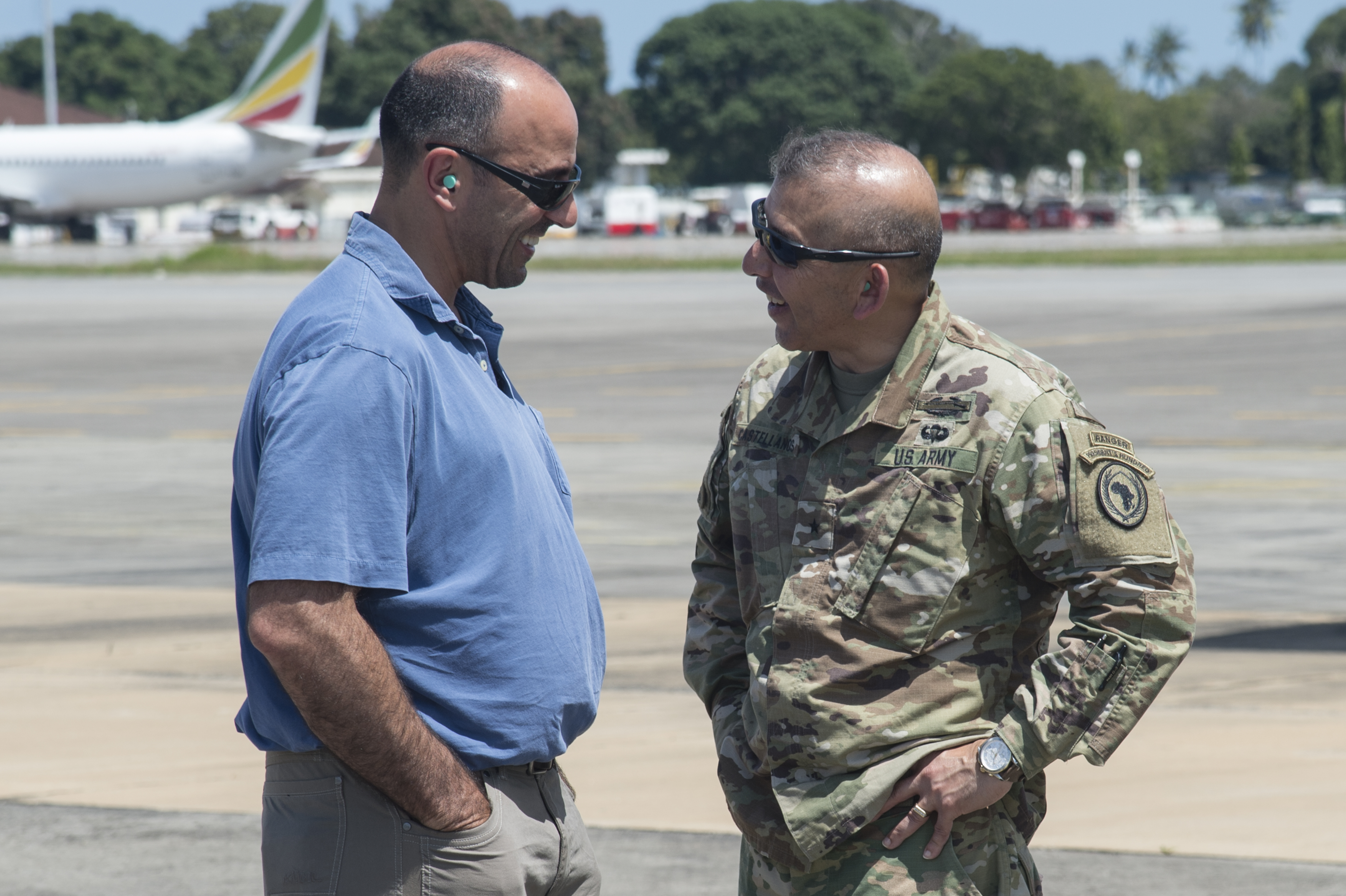 Rep. Jimmy Panetta (D-Calif.), speaks with U.S. Army Brig. Gen. Miguel Castellanos, Combined Joint Task Force-Horn of Africa deputy commanding general in Somalia and Mogadishu Coordination Cell director, during a congressional delegation (CODEL) visit of various locations within the CJTF-HOA area of responsibility. During their three-day visit, the CODEL met U.S. service members and learned more about the U.S. military mission in East Africa. The CODEL included the following congressmen, all of whom are on the House Armed Service Committee; Rep. Austin Scott (R-Ga.) representing the 8th District of Georgia; Rep. Jimmy Panetta (D-Calif.) representing the 20th District of California; and Rep. Marc Veasey (D-Texas) representing the 33rd District of Texas. (U.S. Air National Guard photo by Tech. Sgt. Joe Harwood)