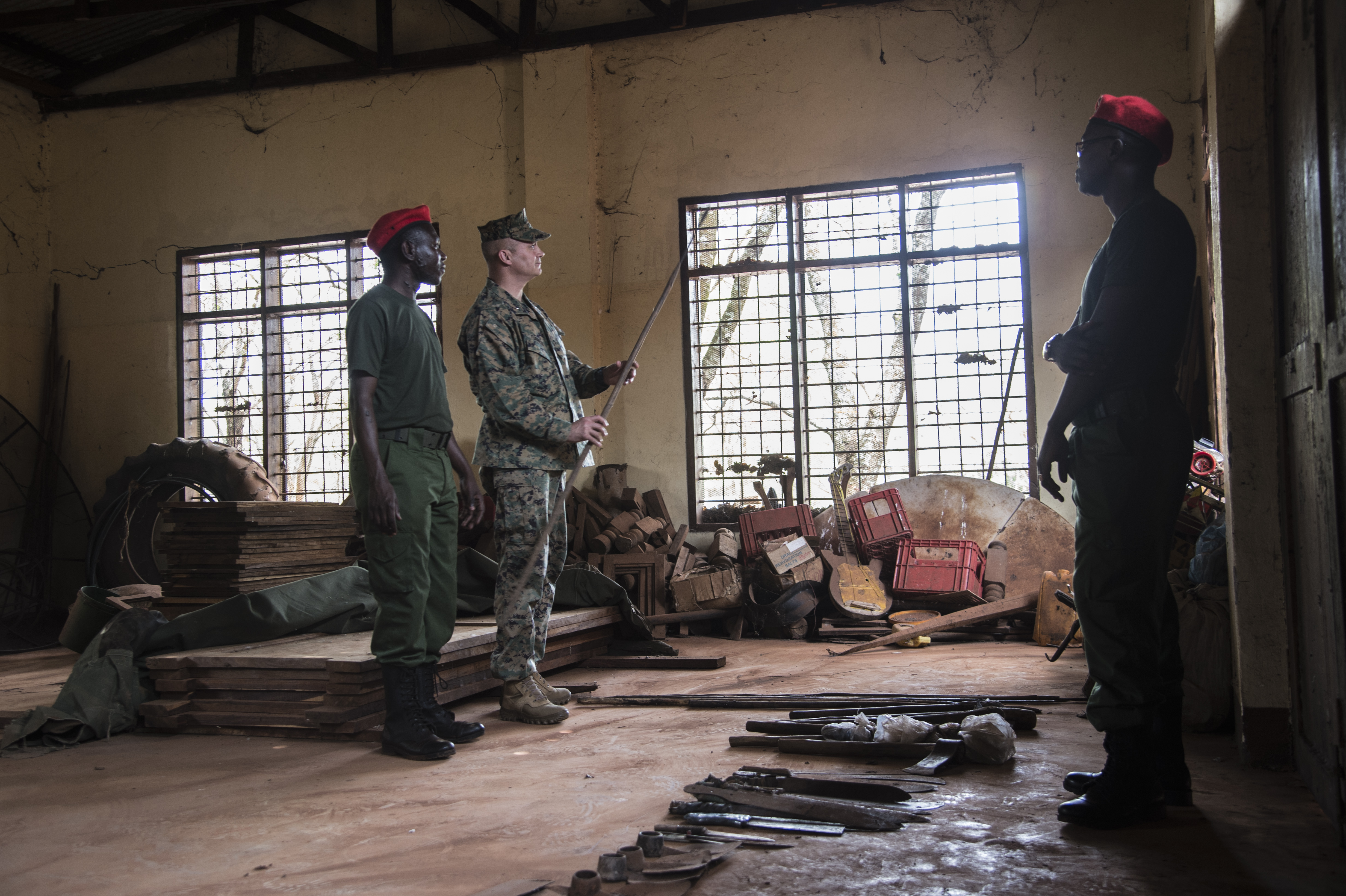 U.S. Marine Corps Brig. Gen. David Furness, Commanding General of Combined Joint Task Force-Horn of Africa, views items obtained from poachers and others involved in illicit trafficking during a visit with CJTF-HOA civil affairs Soldiers who are conducting counter illicit trafficking training at a game reserve in Tanzania, Sept. 28, 2017. CJTF-HOA seeks to develop the capacity of the Tanzanian Wildlife Authority game wardens to conduct effective patrol operations, information management and civil engagement in order to promote local and regional security and counter transnational illicit trafficking networks.  (U.S. Air National Guard photo by Tech. Sgt. Joe Harwood/Released)