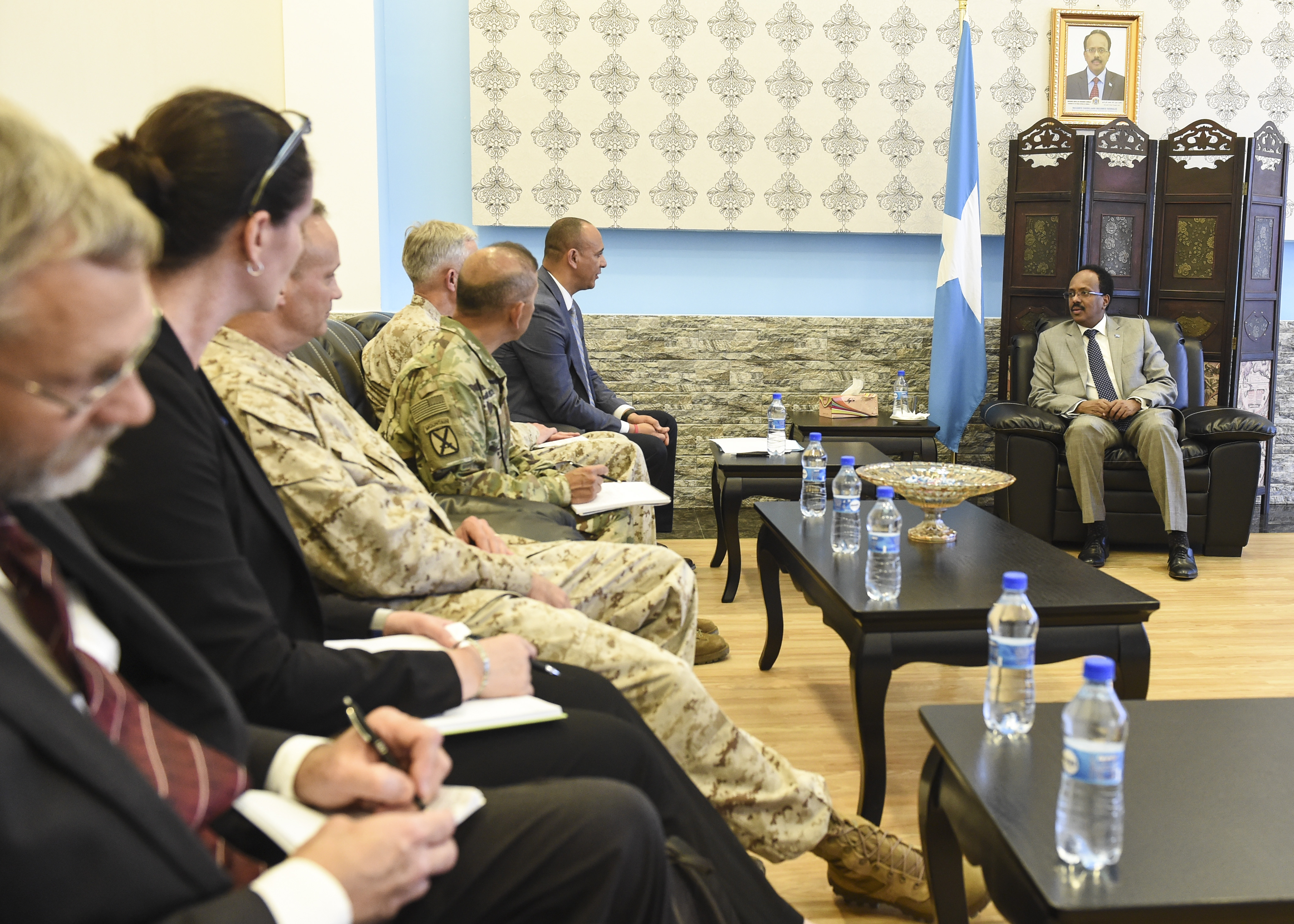 U.S. military and Department of State officials meet with Somalia President Mohamed Abdullahi Mohamed in Mogadishu, Somalia, Oct. 12, 2017. Topics of interest covered during the meeting included U.S. and Somali national interests in the region and opportunities to strengthen the Somali National Security Forces, particularly as the African Union mission in Somalia troops transition out of the security role in coming years. Attendees of the meeting included Martin Dale, the Chargé d'Affaires of the U.S. Mission to Somalia, U.S. Marine Corps Gen. Thomas Waldhauser, U.S. Africa Command commander, U.S. Marine Corps Brig. Gen. David Furness, Combined Joint Task Force – Horn of Africa commanding general, and U.S. Army Brig. Gen. Miguel Castellanos, deputy commanding general of CJTF-HOA in Somalia (U.S. Air Force photo by Staff Sgt. Eboni Prince)