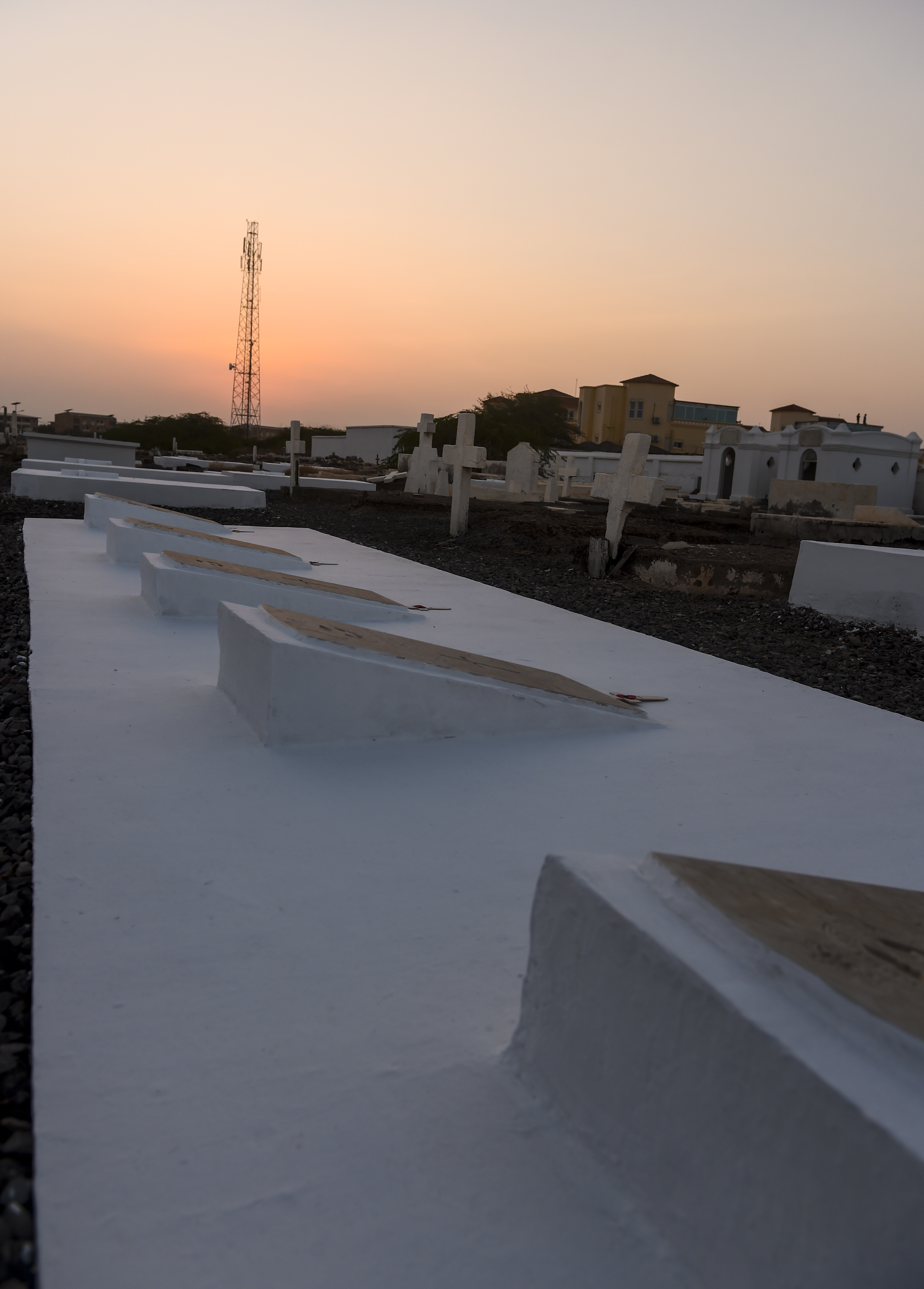 The sun sets over graves at the Djibouti New European Cemetery near Camp Lemonnier, Djibouti, Nov. 7, 2017.  During a Remembrance Day ceremony, service members from Combined Joint Task Force - Horn of Africa joined other representatives of the United States, the United Kingdom, Russia, the Commonwealth, and the European Union as they honored service members who gave their lives during wartime. (U.S. Air Force photo by Staff Sgt. Timothy Moore)