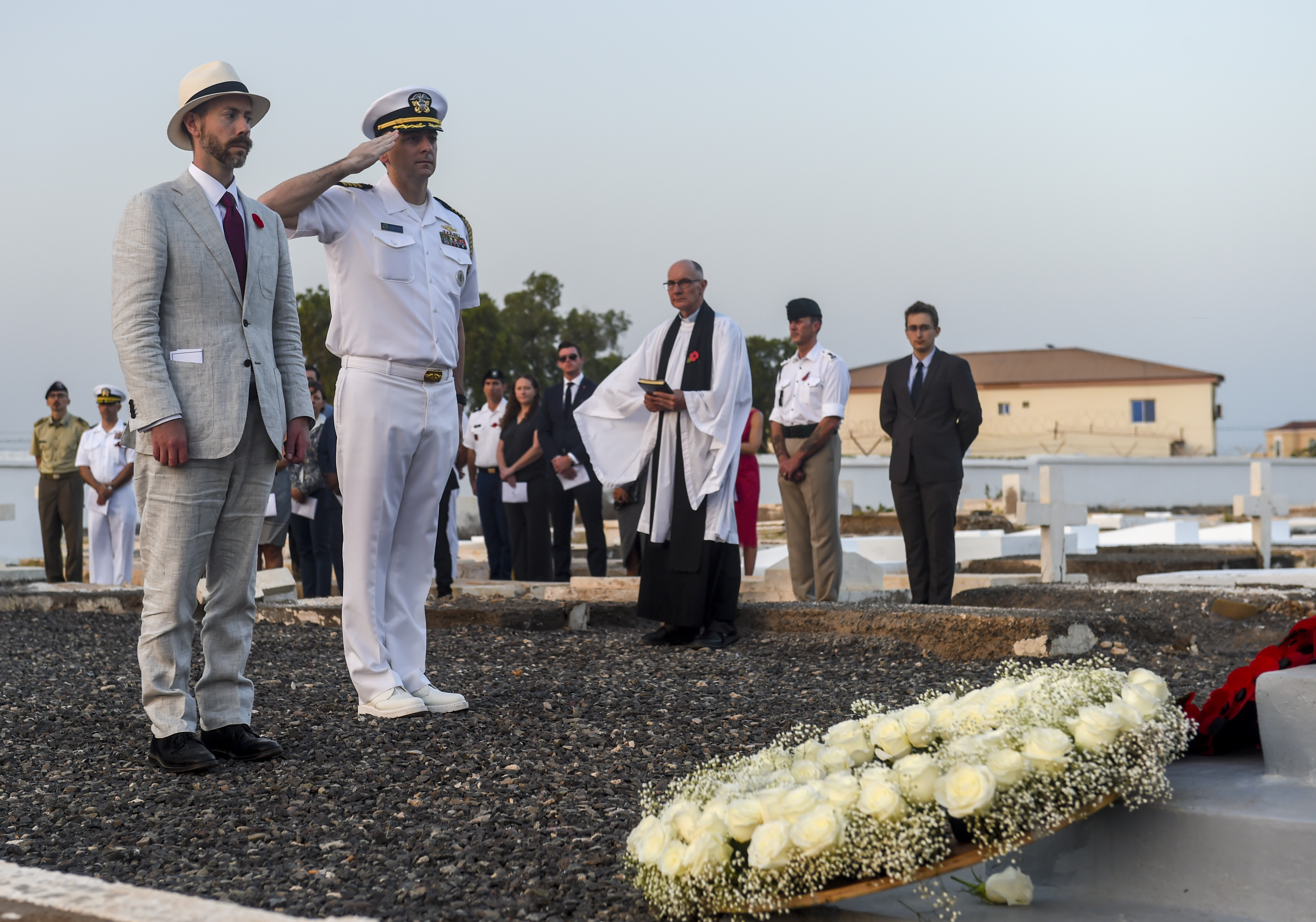 J. Alexander Hamilton (left), Deputy Chief of Mission of U.S. Embassy to the Republic of Djibouti, and U.S. Navy Capt. John Tully, senior defense official and defense attaché, pay their respects during a Remembrance Day ceremony at the Djibouti New European Cemetery near Camp Lemonnier, Djibouti, Nov. 7, 2017. Service members from Combined Joint Task Force - Horn of Africa joined other representatives of the United States, the United Kingdom, Russia, the Commonwealth, and the European Union as they honored service members who gave their lives during wartime. (U.S. Air Force photo by Staff Sgt. Timothy Moore)