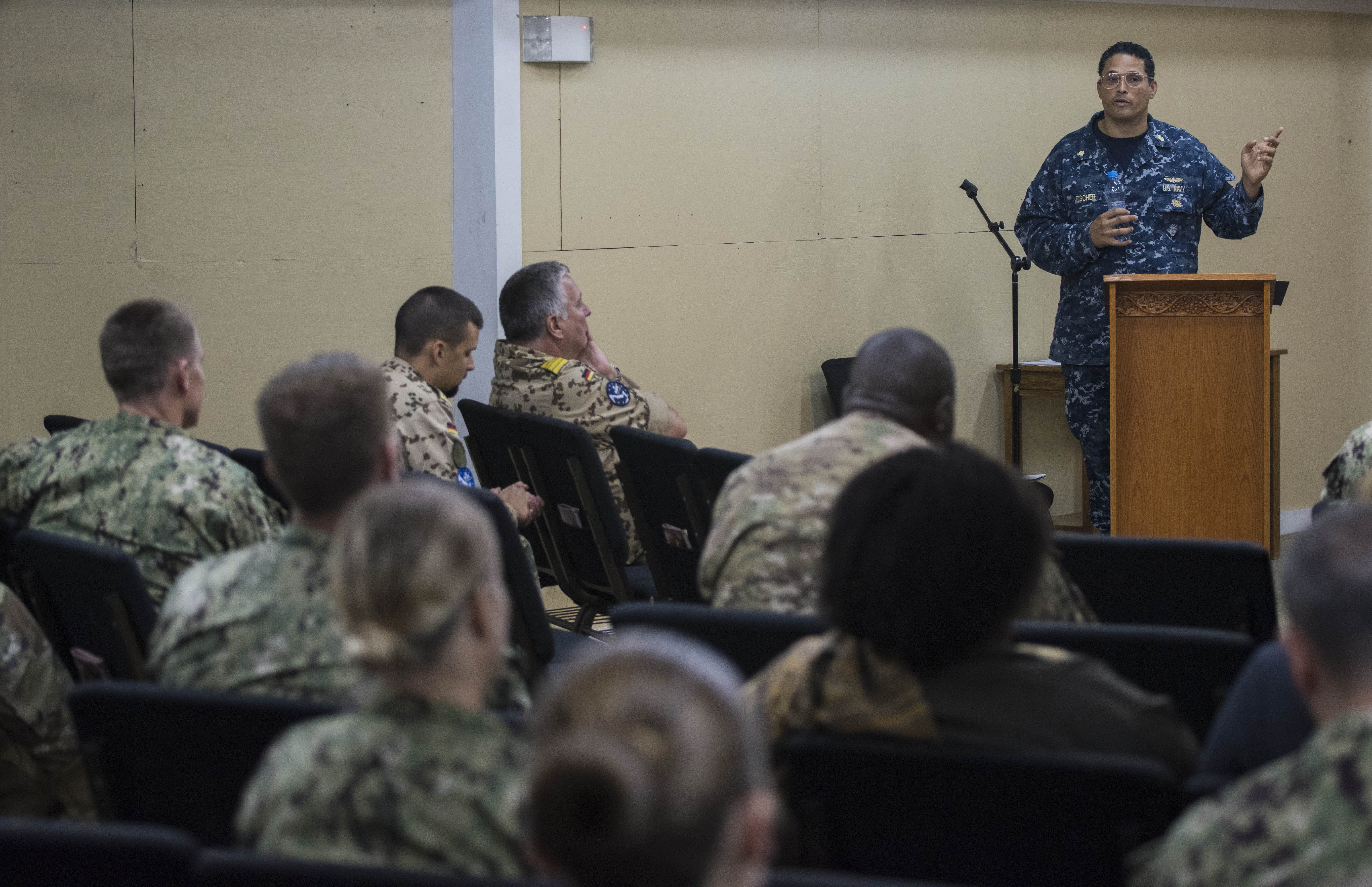 U.S. Navy Lt. Cmdr. Stephen Fischer, a preventative medicine physician from Walter Reed National Military Medical Center, speaks to other medical professionals at a Military Tropical Medicine Course organized by the Combined Joint Task Force – Horn of Africa Surgeon Cell and the Navy Medicine Professional Development Center at Camp Lemonnier, Djibouti, Nov. 14, 2017. Medical professionals from across the U.S. military services, foreign militaries and local community joined together Nov. 14 to 16 to discuss challenges posed to medical personnel providing care for troops operating within the Horn of Africa and the East African region. (U.S. Air National Guard photo by Staff Sgt. Allyson L. Manners)