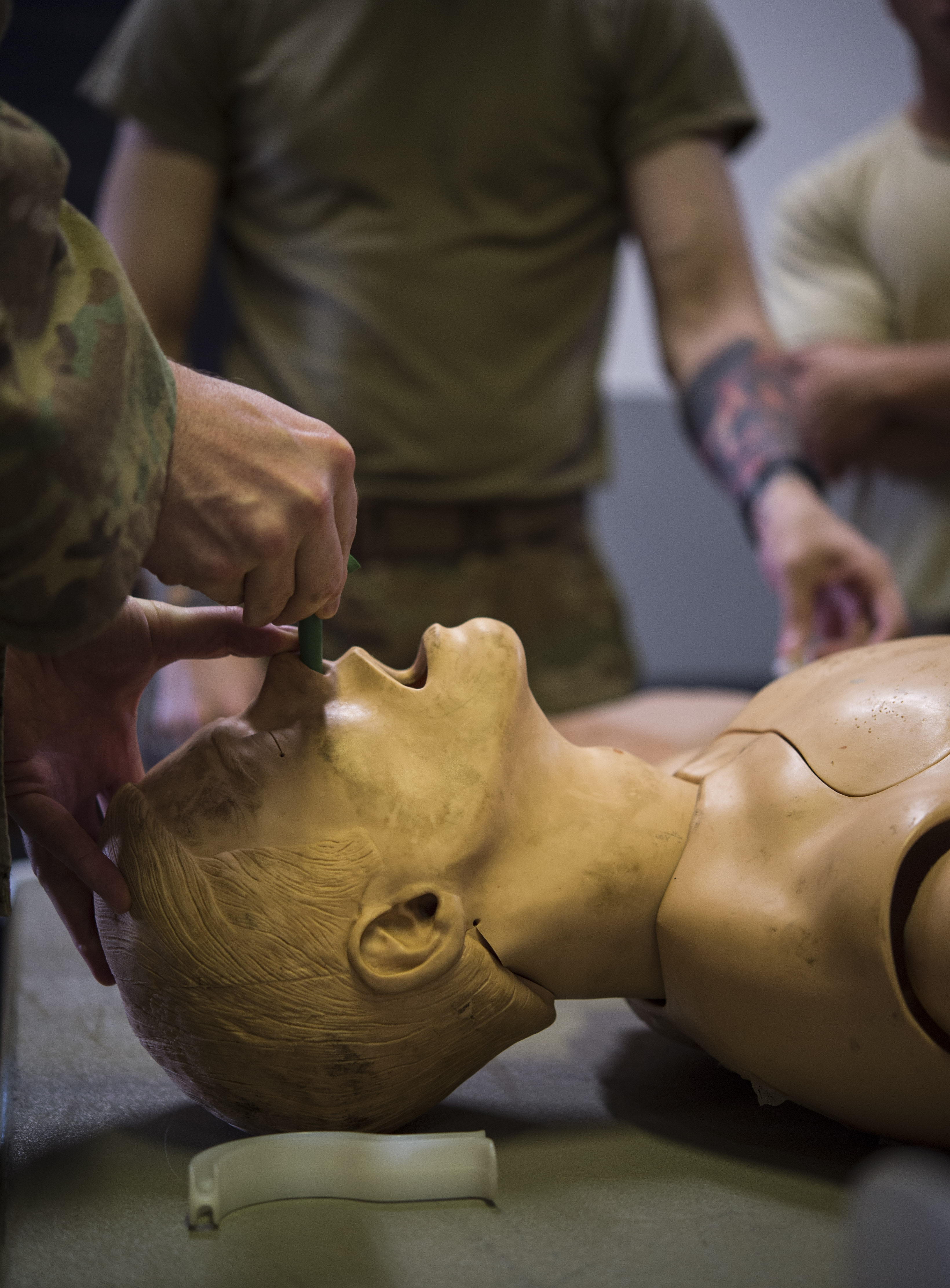 U.S. Army Cpl. Michael Pasichnyk, assigned to the 3rd Battalion, 144th Infantry Regiment Task Force Bayonet, attached to the Combined Joint Task Force – Horn of Africa, demonstrates how to insert a nasopharyngeal airway during a U.S. Army Combat Lifesaver Course held at Camp Lemonnier, Djibouti, Nov. 29, 2017. The five-day course focused on teaching students how to administer lifesaving tactical medical care to wounded service members on the battlefield. (U.S. Air Force photo by Staff Sgt. Timothy Moore)