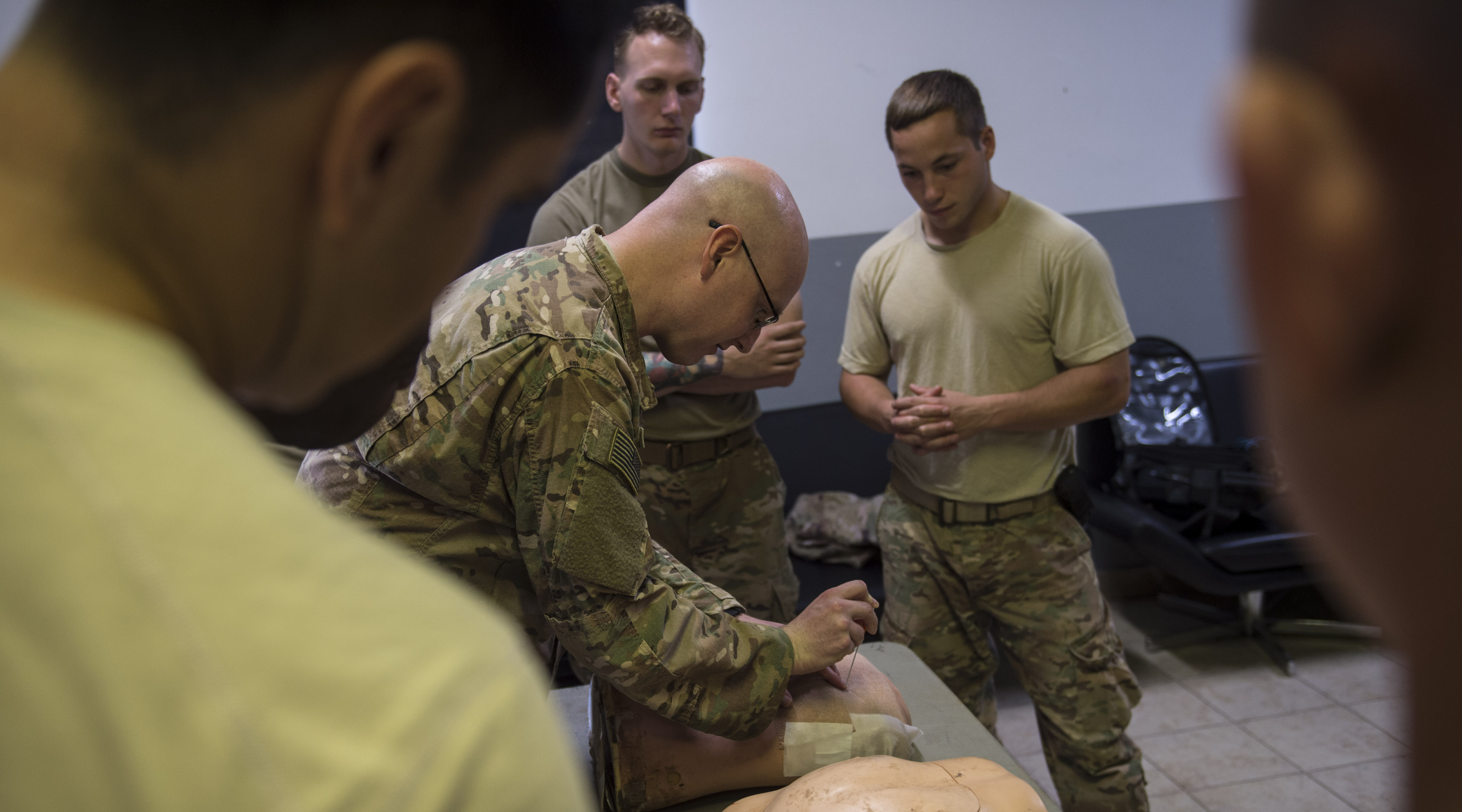 U.S. Army Cpl. Michael Pasichnyk, assigned to 3rd Battalion, 144th Infantry Regiment Task Force Bayonet, attached to the Combined Joint Task Force - Horn of Africa, demonstrates how to perform a needle chest decompression during a U.S. Army Combat Lifesaver Course held at Camp Lemonnier, Djibouti, Nov. 29, 2017. The five-day course focused on teaching students how to administer lifesaving tactical medical care to wounded service members on the battlefield. (U.S. Air Force photo by Staff Sgt. Timothy Moore)