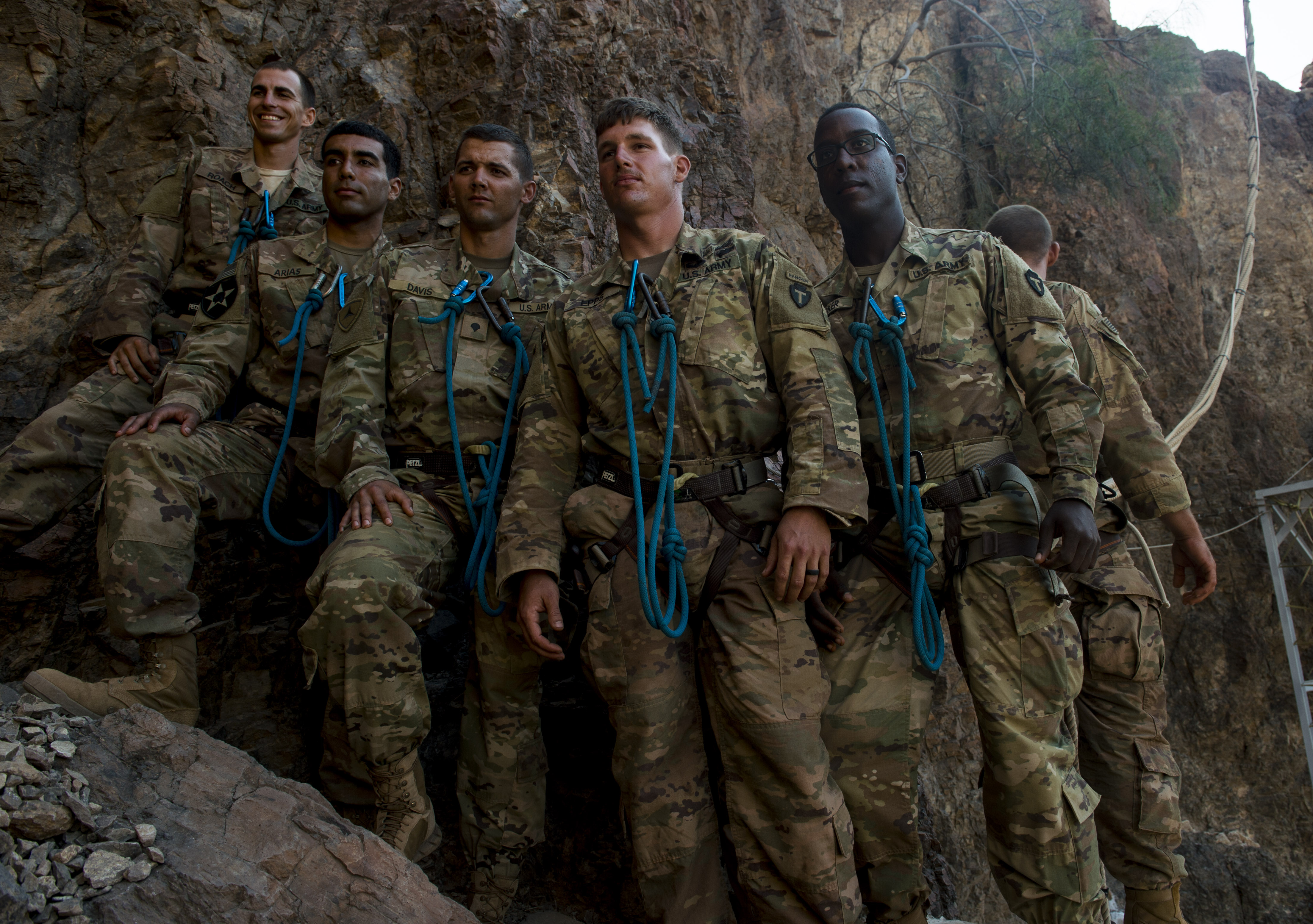 U.S. Army Soldiers assigned to the 3rd Battalion, 144th Infantry Regiment, Task Force Bayonet, attached to the Combined Joint Task Force - Horn of Africa, pose for a photograph at the start of the mountain obstacle portion of the French Desert Commando Course held at Arta, Djibouti, Dec. 3, 2017. Thirty U.S. service members participated in the obstacle course alongside French marines assigned to the 5th Overseas Interarms Regiment, Djibouti. (U.S. Air Force photo by Staff Sgt. Timothy Moore)