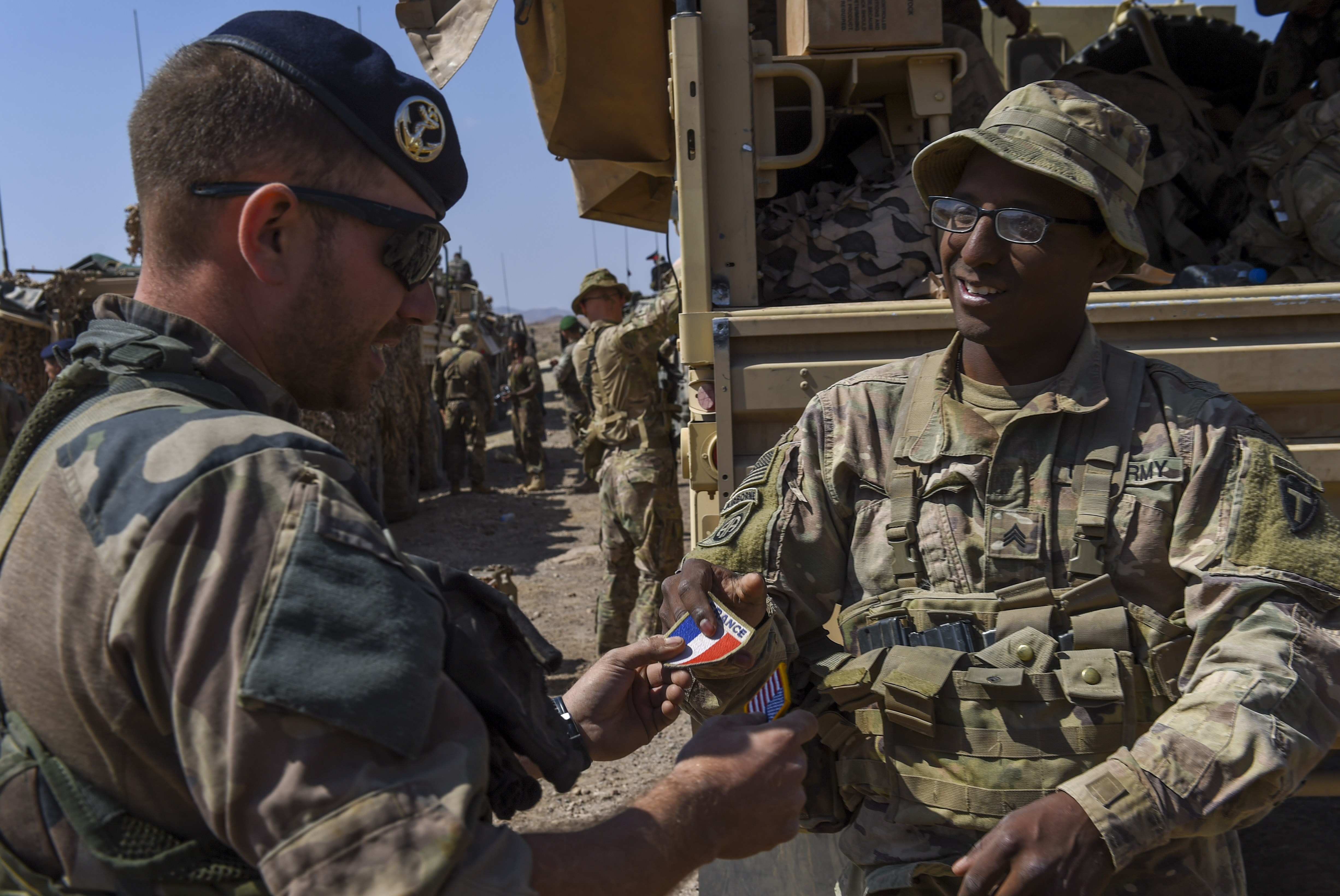 U.S. Army Sgt. Able Ballejo (right), assigned to 3rd Battalion, 144th Infantry Regiment, Task Force Bayonet, attached to Combined Joint Task Force - Horn of Africa (CJTF-HOA), trades patches with a French marine after the graduation ceremony of a French Desert Commando Course near Ali Sabieh, Djibouti, Dec. 7, 2017. U.S. service members assigned to CJTF-HOA participated in the 12-day course, in which they learned the fundamentals of desert combat, survival, and troop movements while also bridging language and cultural barriers between French and American troops. (U.S. Air Force photo by Staff Sgt. Timothy Moore)