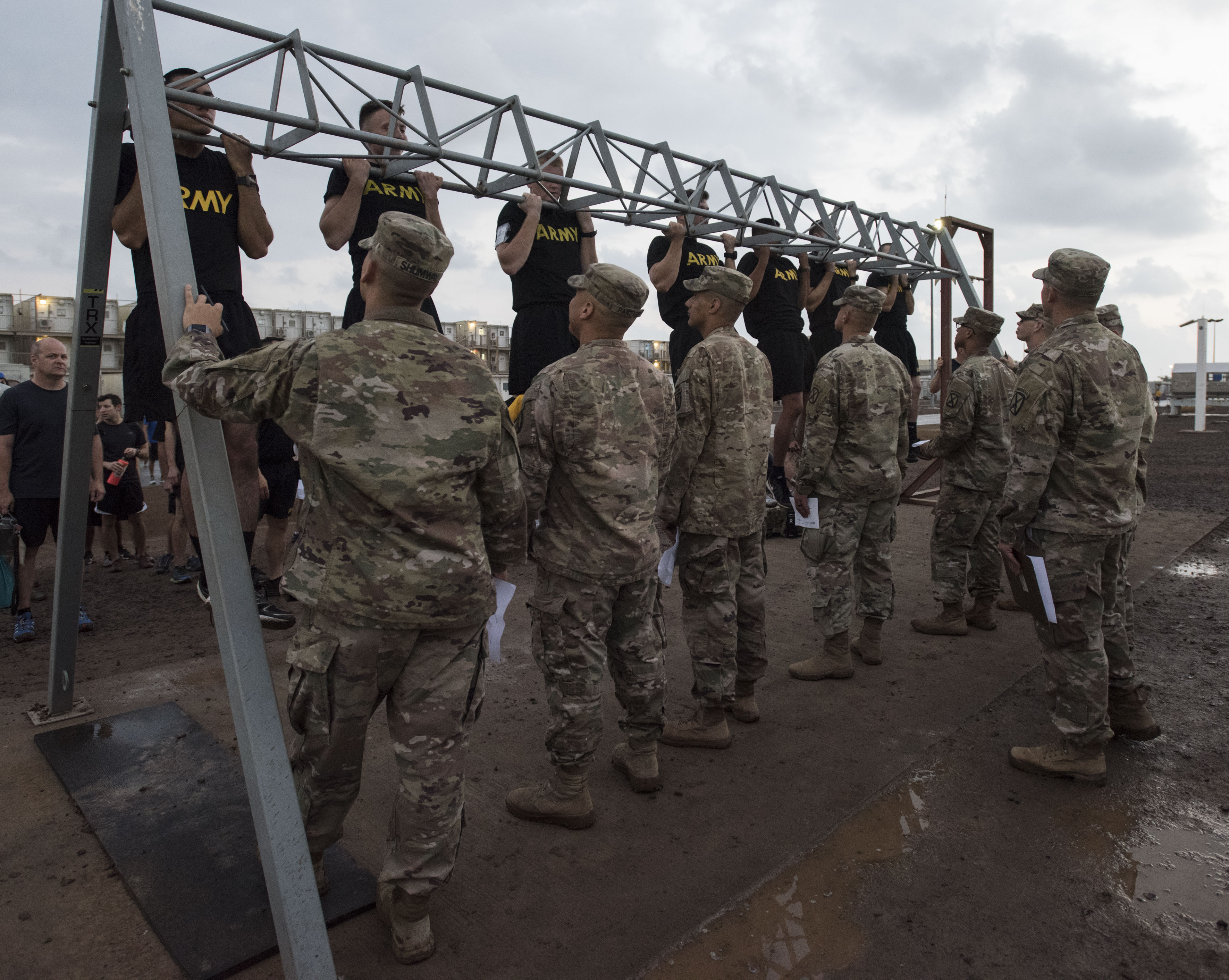 U.S. service members assigned to Combined Joint Task Force-Horn of Africa complete a physical fitness test as part of the competition to earn the German Armed Forces Proficiency Badge (GAFPB), a decoration of the Armed Forces of the Federal Republic of Germany, at Camp Lemonnier, Djibouti, Nov. 27, 2017. Competitors must complete a physical fitness test, uniformed swim, weapons qualification, ruck march, first aid course and chemical warfare course to be awarded the GAFPB, one of the few foreign allied military awards that U.S. service members are authorized to wear. (U.S. Air National Guard photo by Staff Sgt. Allyson L. Manners)