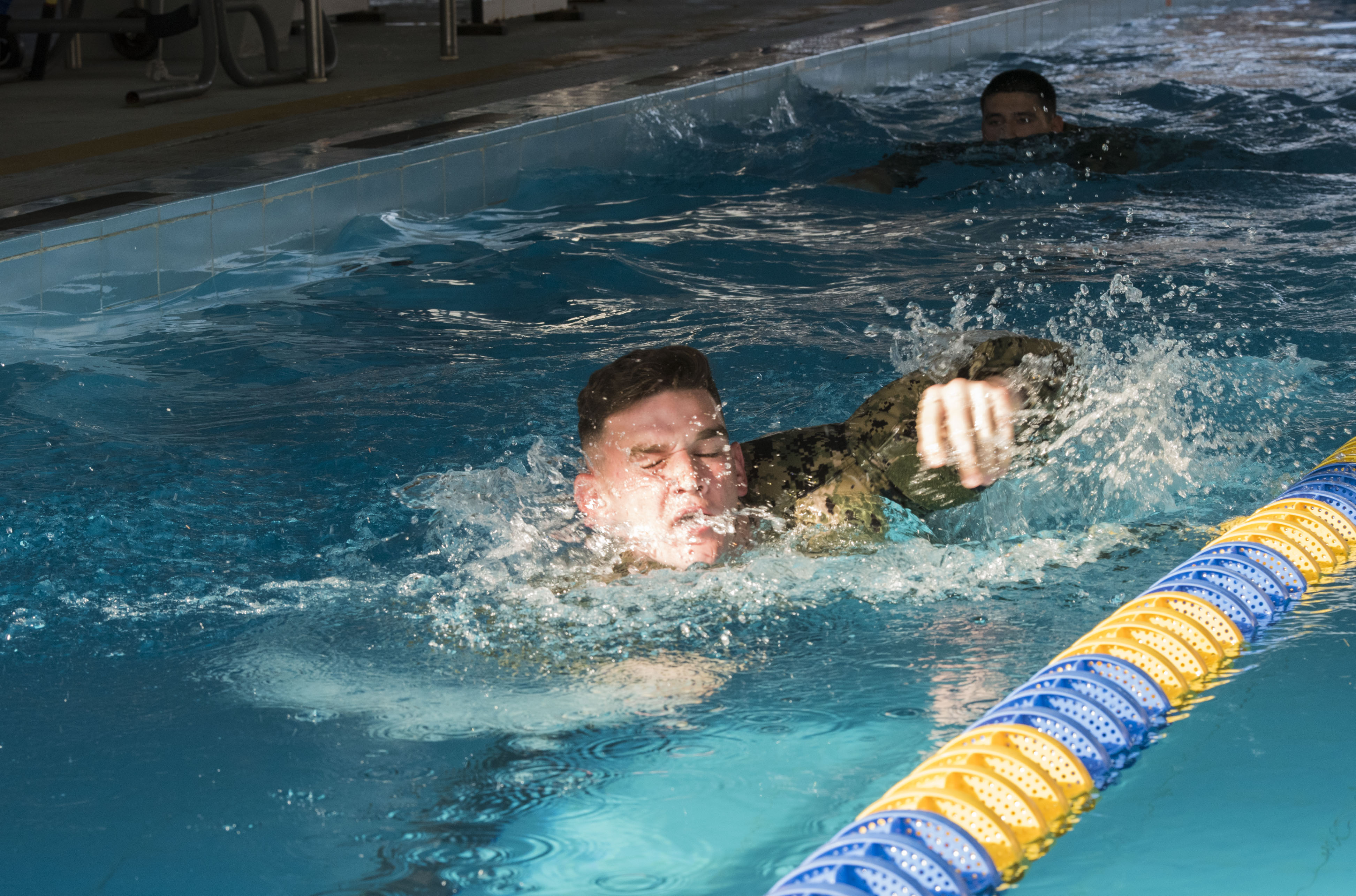 U.S. service members assigned to Combined Joint Task Force-Horn of Africa complete a swim test in uniform as part of the competition to earn the German Armed Forces Proficiency Badge (GAFPB), a decoration of the Armed Forces of the Federal Republic of Germany, at Camp Lemonnier, Djibouti, Nov. 28, 2017. Competitors must complete a physical fitness test, uniformed swim, weapons qualification, ruck march, first aid course and chemical warfare course to be awarded the GAFPB, one of the few foreign allied military awards that U.S. service members are authorized to wear. (U.S. Air National Guard photo by Staff Sgt. Allyson L. Manners)